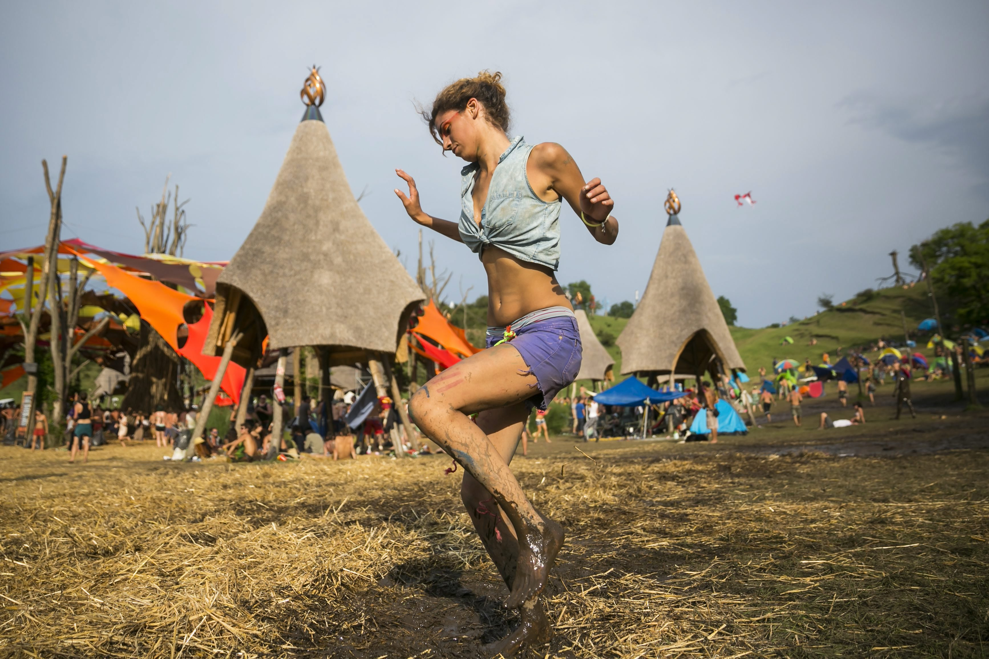 Aug. 2, 2014. A young woman dances during the 2014 O.Z.O.R.A. Festival, described by organizers as the Psychedelic Tribal Gathering, near the village of Ozora, south of Budapest, Hungary.