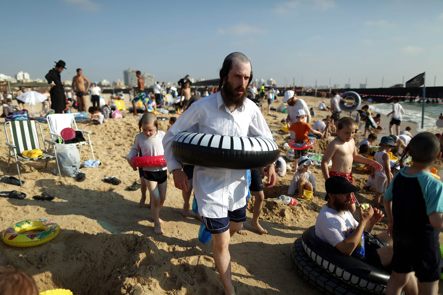 Ultra Orthodox Jews  enjoying summer time at the beach  with their families in the southern city of Ashdod, Israel on August 13, 2014.