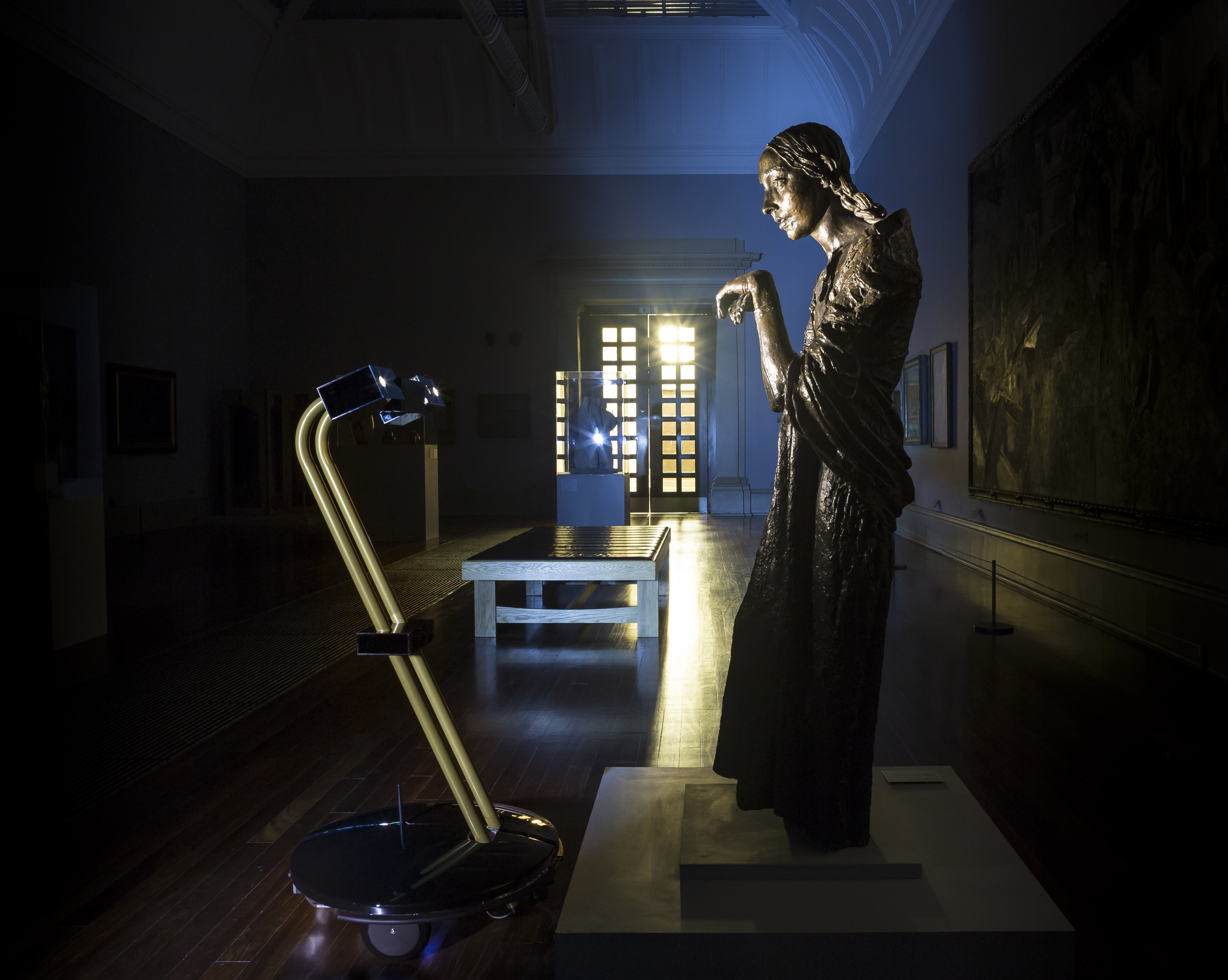 After Dark project robot with Jacob Epstein's The Visitation (1926) at Tate Britain