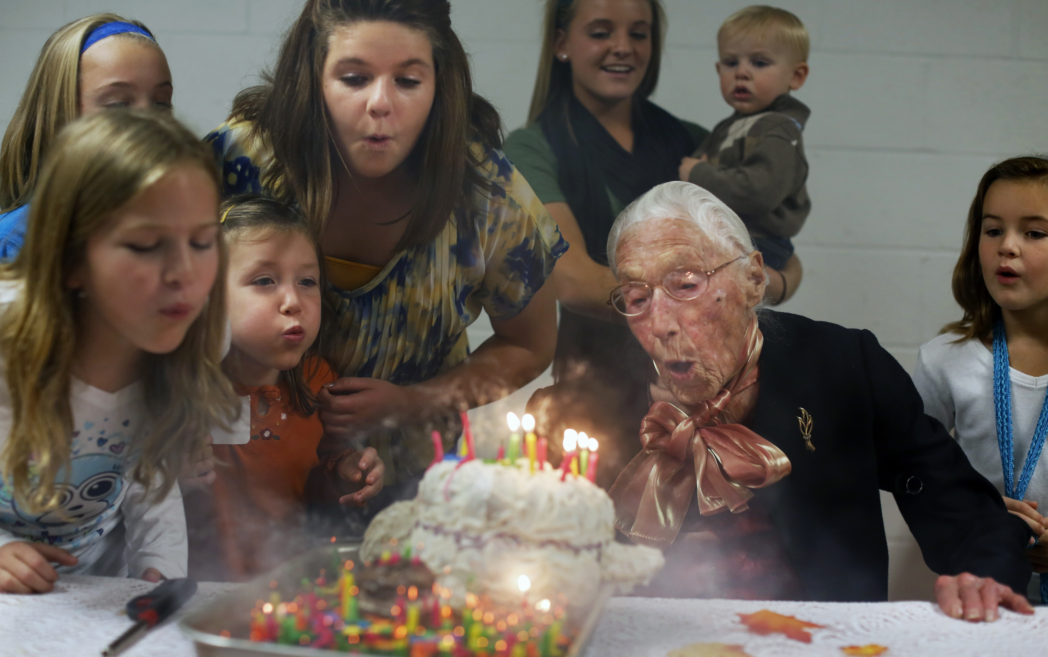 Anna Stoehr is photographed blowing out the 112 candles on her birthday cake with the help of her great grandchildren and about 180 guests on Oct. 14, 2012 in Millville, Minn. She is now 113.
