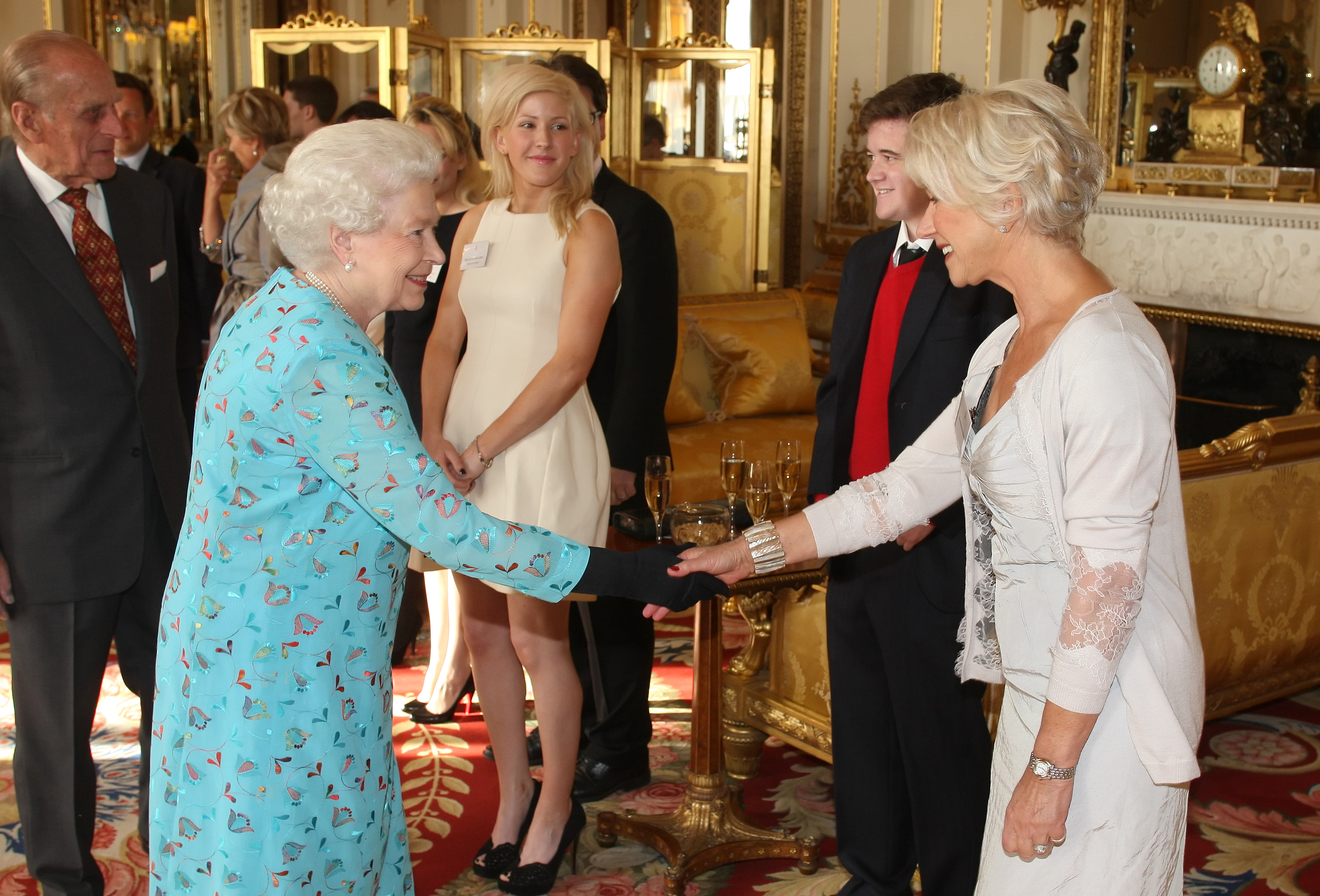 Queen Elizabeth II meets with Dame Helen Mirren (R) at a performing Arts reception at Buckingham Palace on May 9, 2011 in London, England.