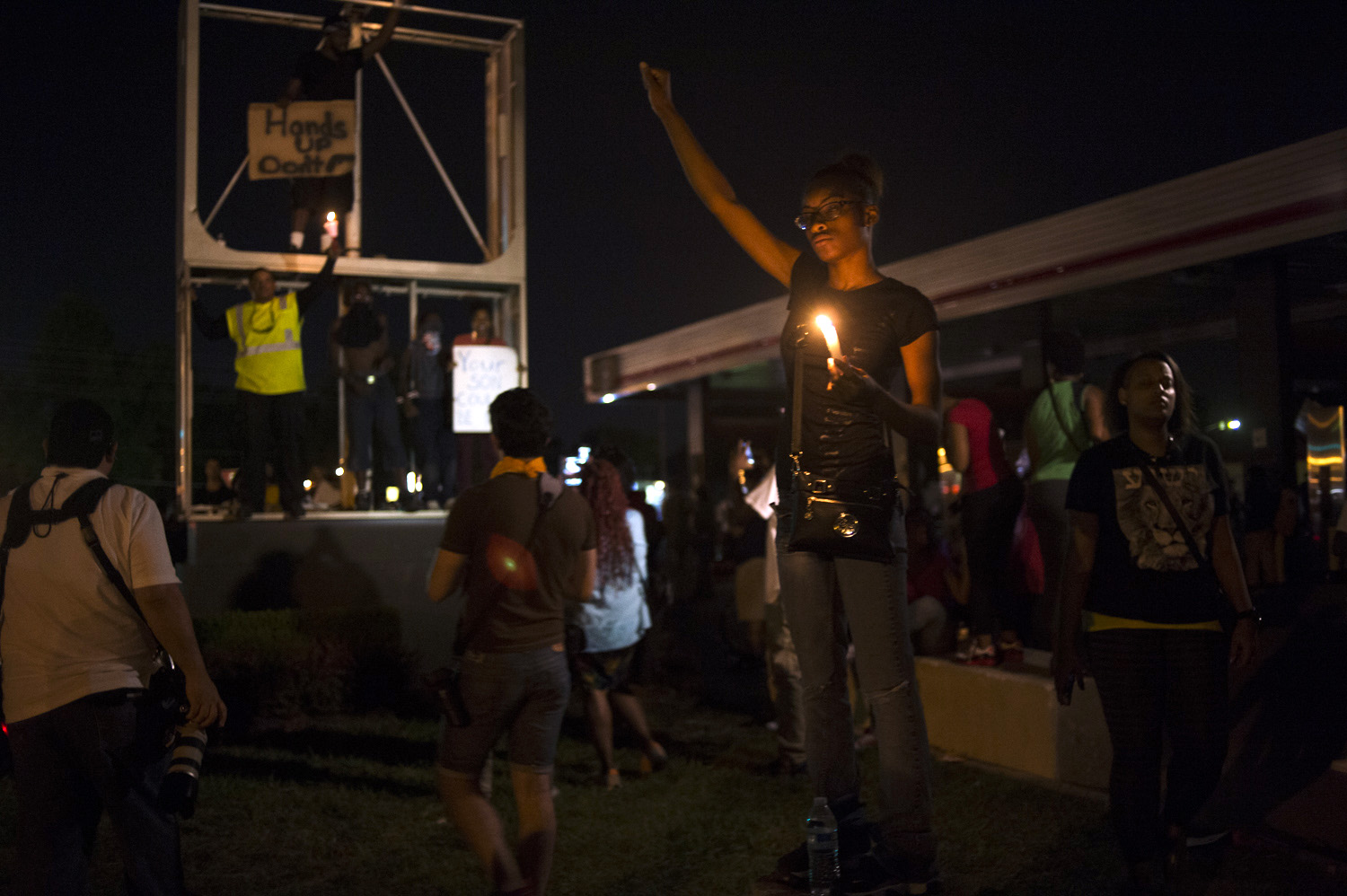 After several days of violent protests and intense confrontations between local police  and protestors, the police decided to pull back and allow the protestors to march peacefully and protest, Ferguson, Mo., Aug. 14, 2014.