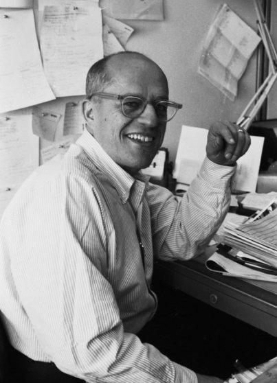 LIFE photographer and editor David Scherman at his desk, 1960.