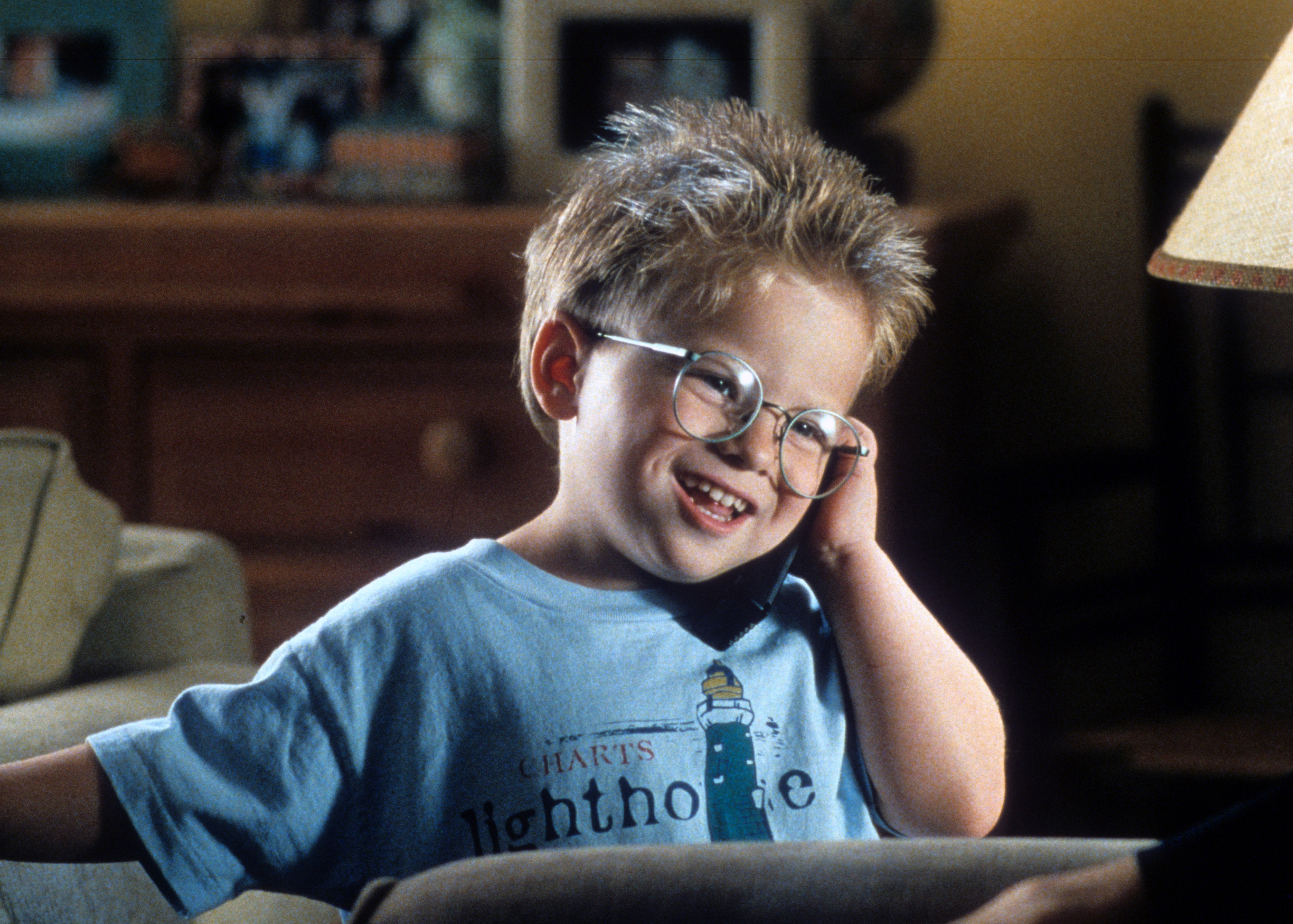 Jonathan Lipnicki talks on a phone in a scene from the film 'Jerry Maguire', 1996.