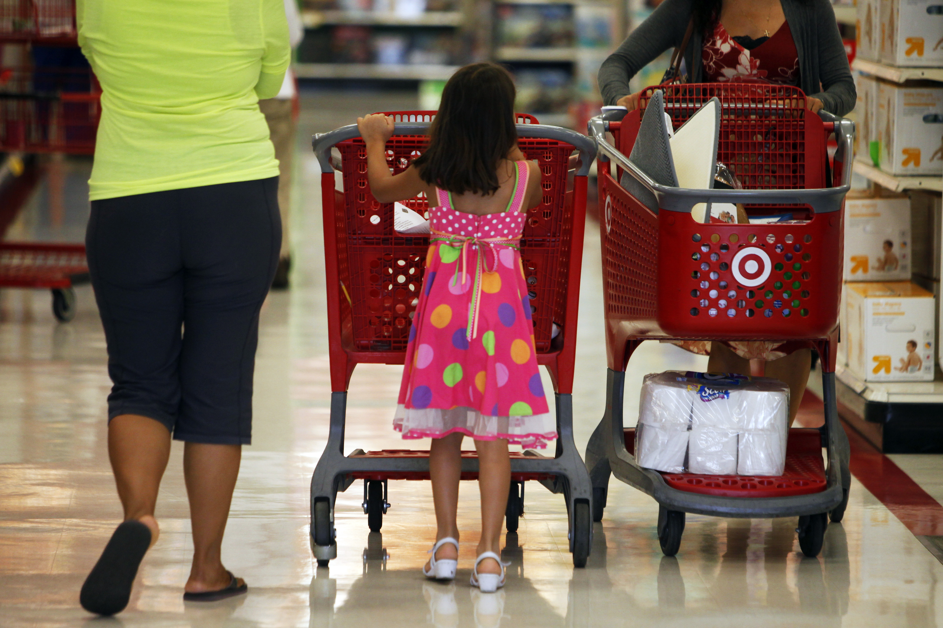 A young girl pushes a Target Corp. shopping cart inside a Target Store in Torrance, California, U.S., on Tuesday, August 20, 2013.