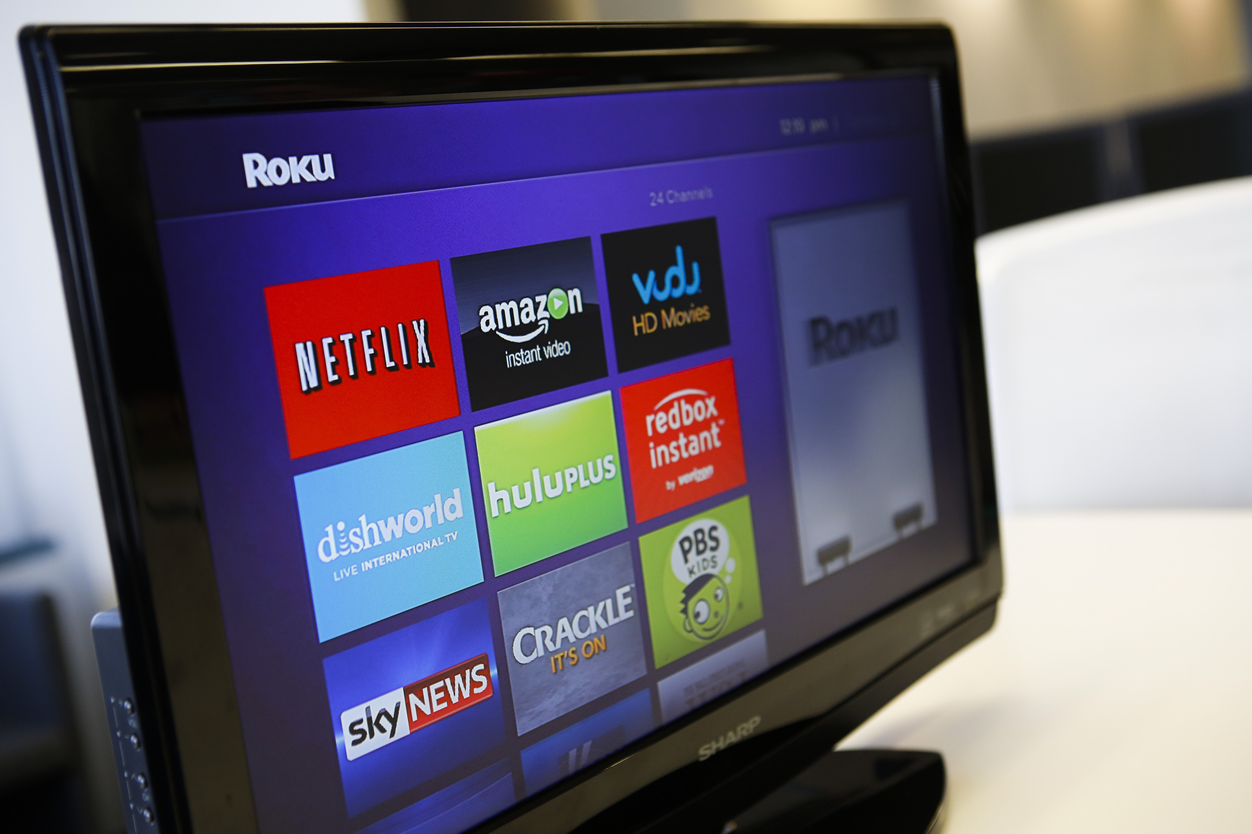 The Roku 3 television streaming player menu screen featuring Netflix, Amazon, Vudu, Hulu, and Redbox Instant is shown on a television in Los Angeles on Sept. 12, 2013.
