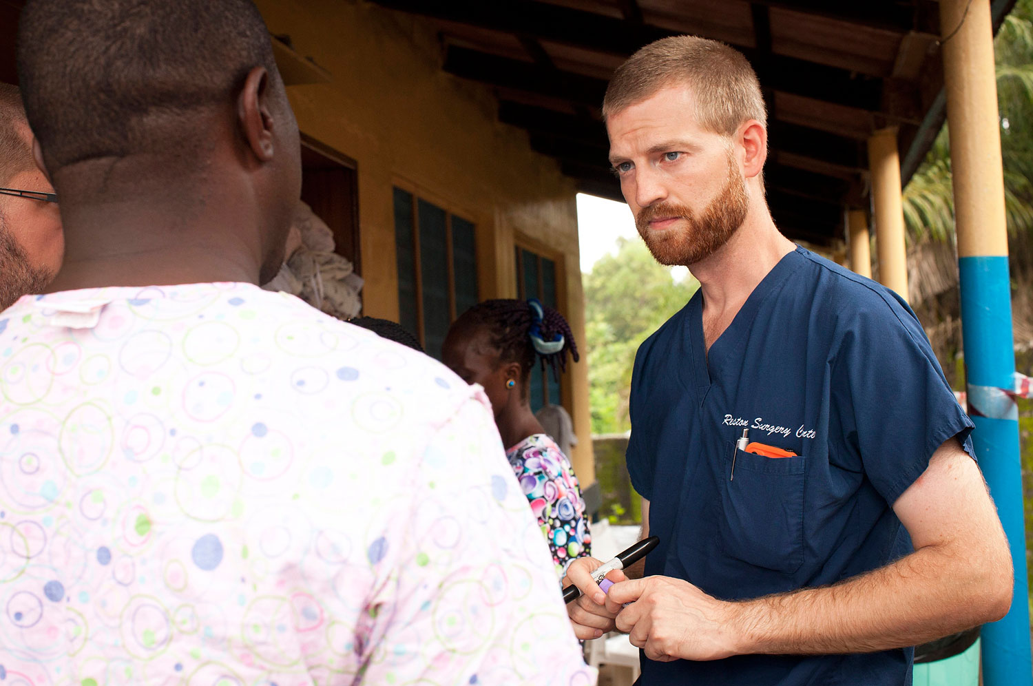In an undated handout photograph courtesy of Samaritan's Purse, Dr. Kent Brantly, right,  with colleagues at the case management center on the campus of ELWA Hospital in Monrovia, Liberia. Brantly, who  contracted Ebola, is receiving treatment at Emory University Hospital in Atlanta