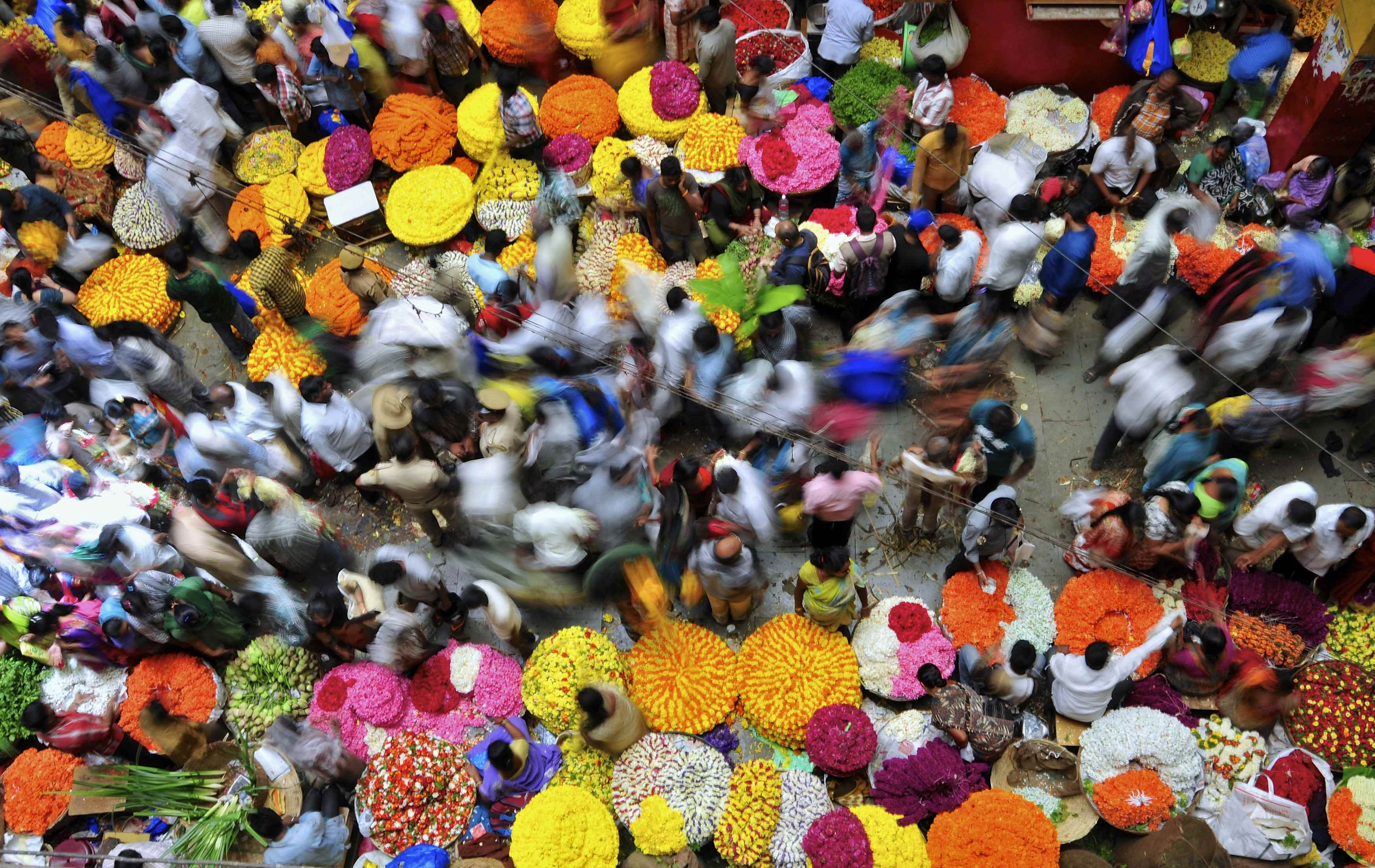 Aug. 7, 2014. People crowd at a flower market in the southern Indian city of Bangalore.