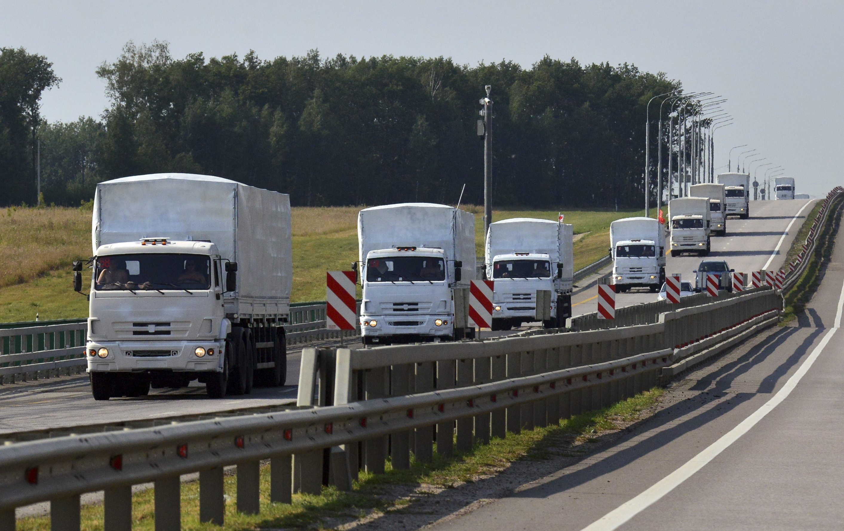 A Russian convoy of trucks carrying humanitarian aid for Ukraine drives along a road near the city of Yelets August 12, 2014.