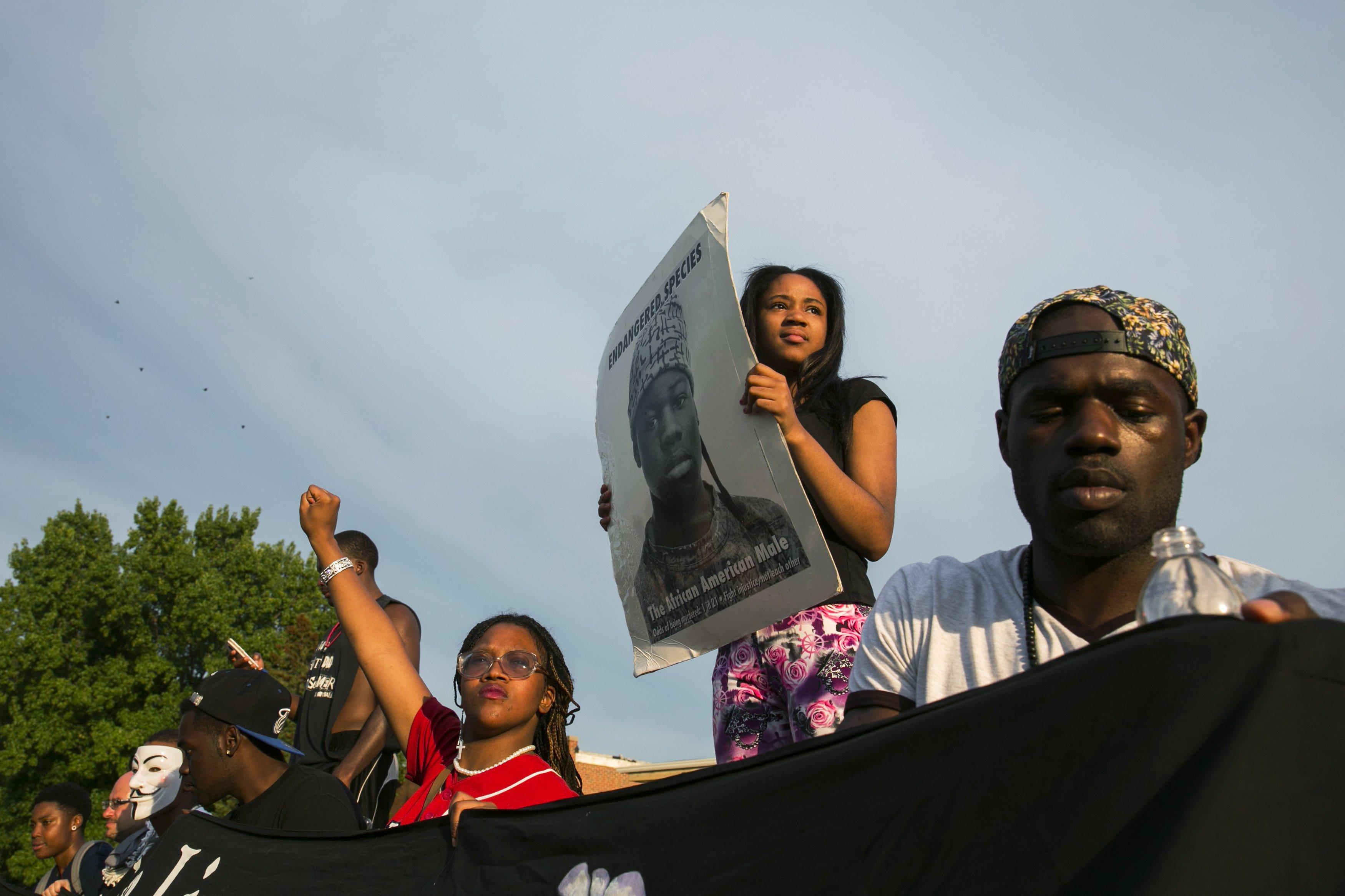 Demonstrators protest outside of Greater St. Marks Family Church in Ferguson, Mo. on Aug. 14, 2014.