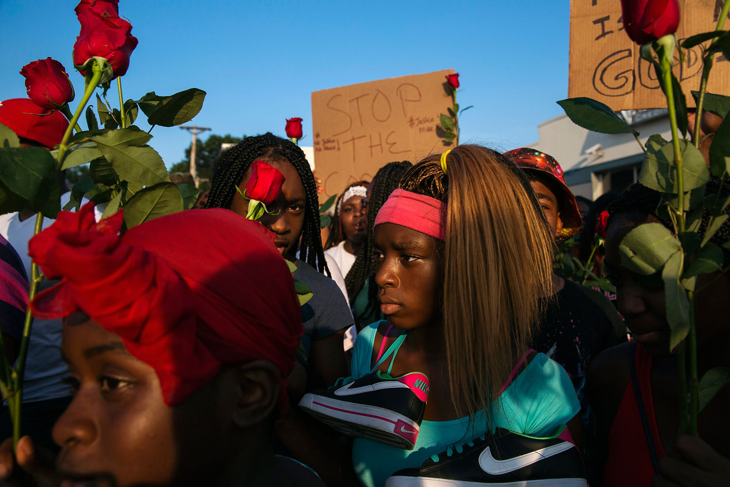 Demonstrators march down West Florissant during a peaceful march in reaction to the shooting of Michael Brown, near Ferguson, Missouri Aug. 18, 2014.