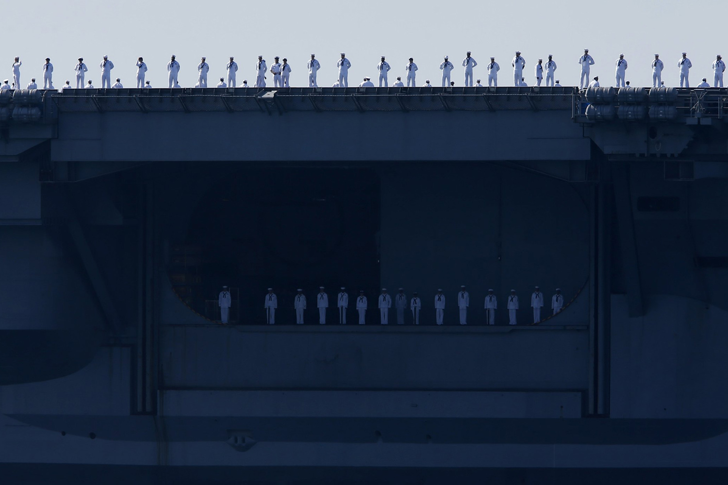 Aug. 22, 2014. Sailors man the rails of the USS Carl Vinson, a Nimitz-class aircraft carrier, as it departs its home port in San Diego, California.