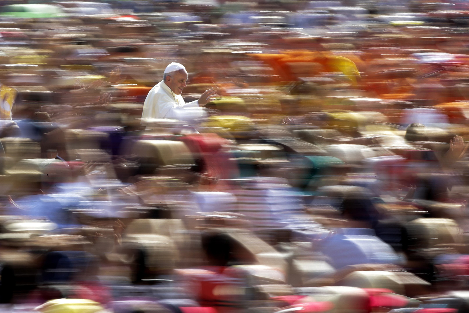 Aug. 27, 2014. Pope Francis waves as he arrives to lead his weekly audience in Saint Peter's Square at the Vatican.