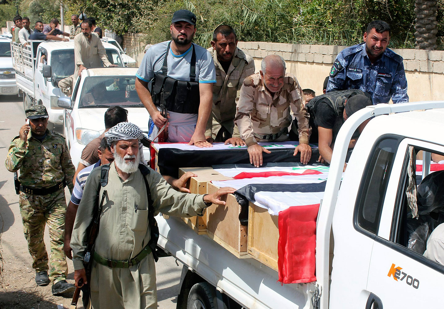 Mourners carry the coffins of Iraqi Shi'ite volunteers who were killed during clashes with militants of the Islamic State of Iraq and Greater Syria in Amerli, during a funeral in Khalis, Iraq, on Aug. 31, 2014