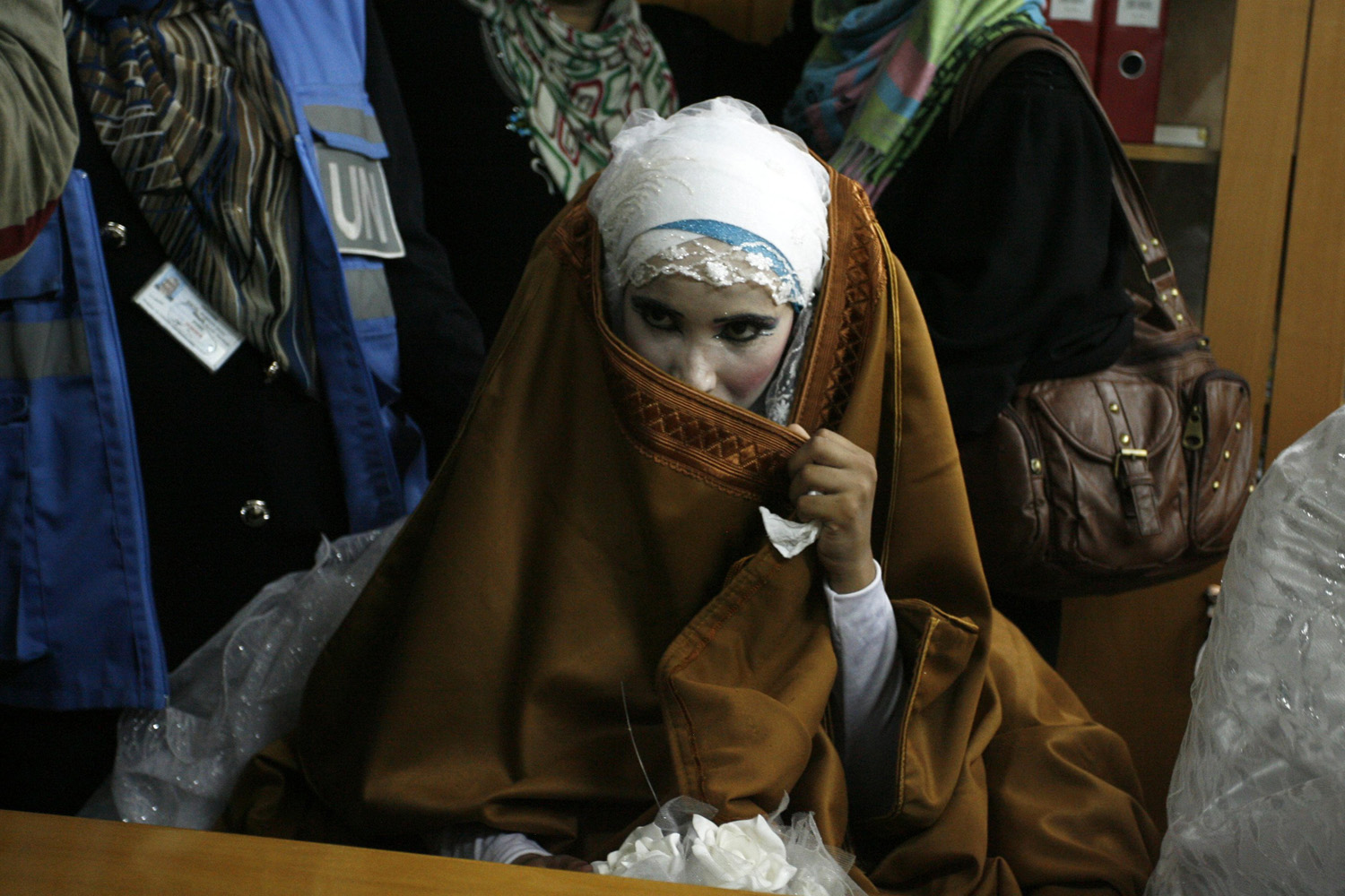 August 17, 2014.  A Palestinian bride, who lost her home during fighting between Hamas and Israel, poses during her wedding ceremony, along with two other couples, at a UN school in Rafah in southern Gaza Strip.