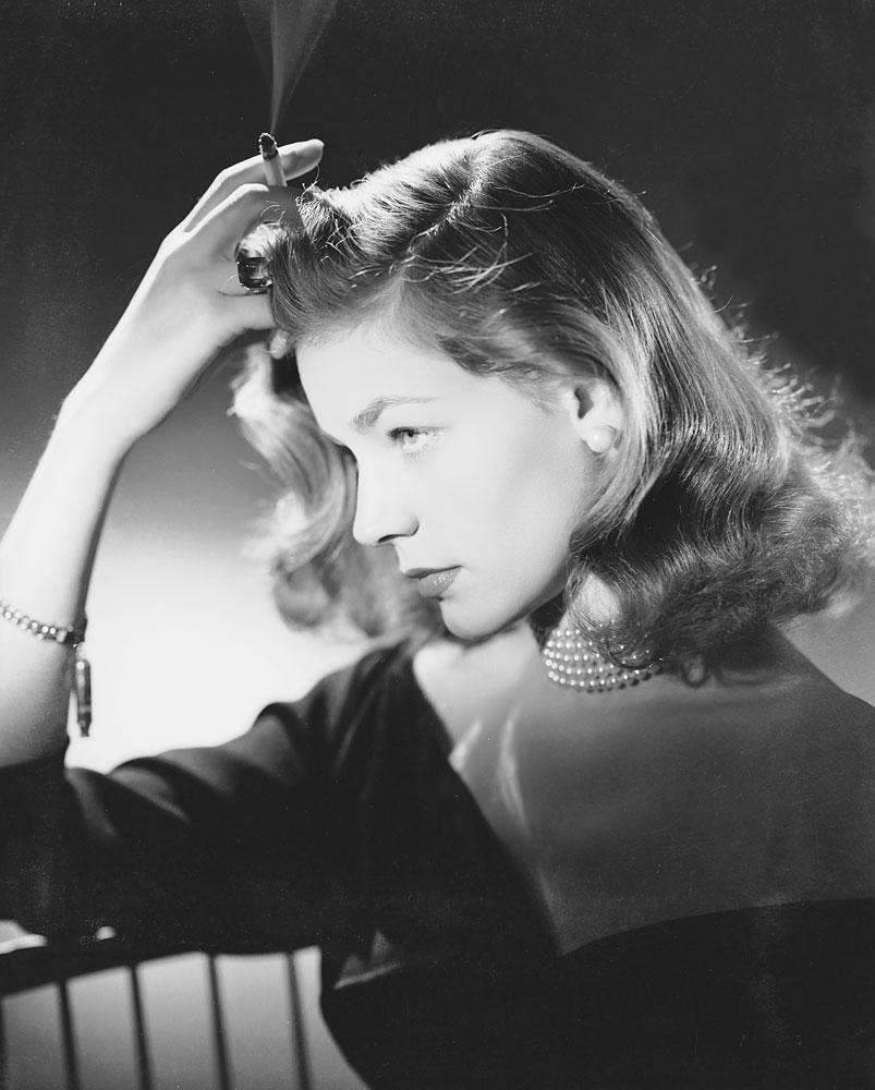 Smoking a cigarette, circa 1950.