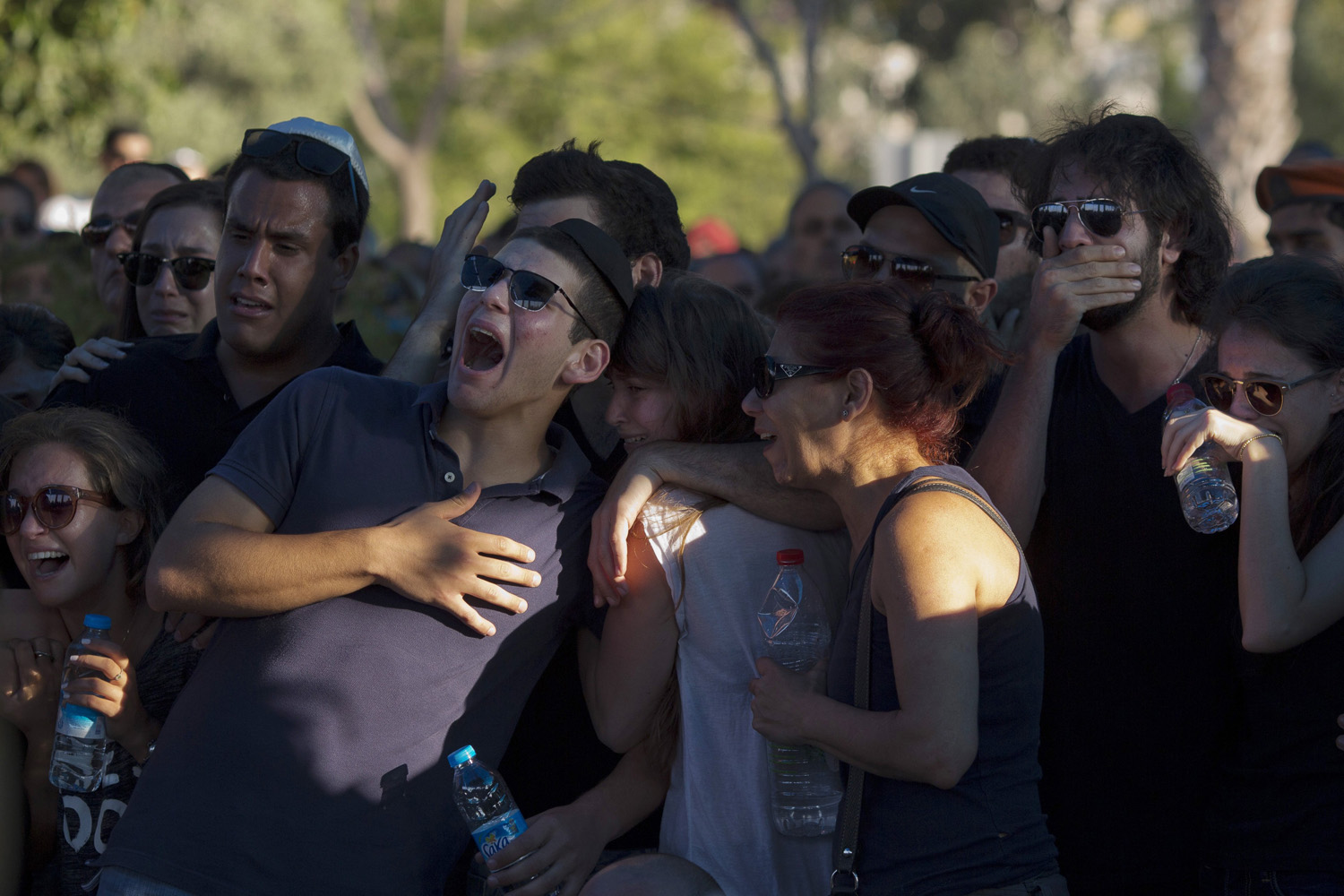Jul. 31, 2014. Friends of Staff Sgt. Matan Gotlib, a Maglan elite unit soldier, morn during his funeral in the military cemetery in Rishon Letzion, central Israel.