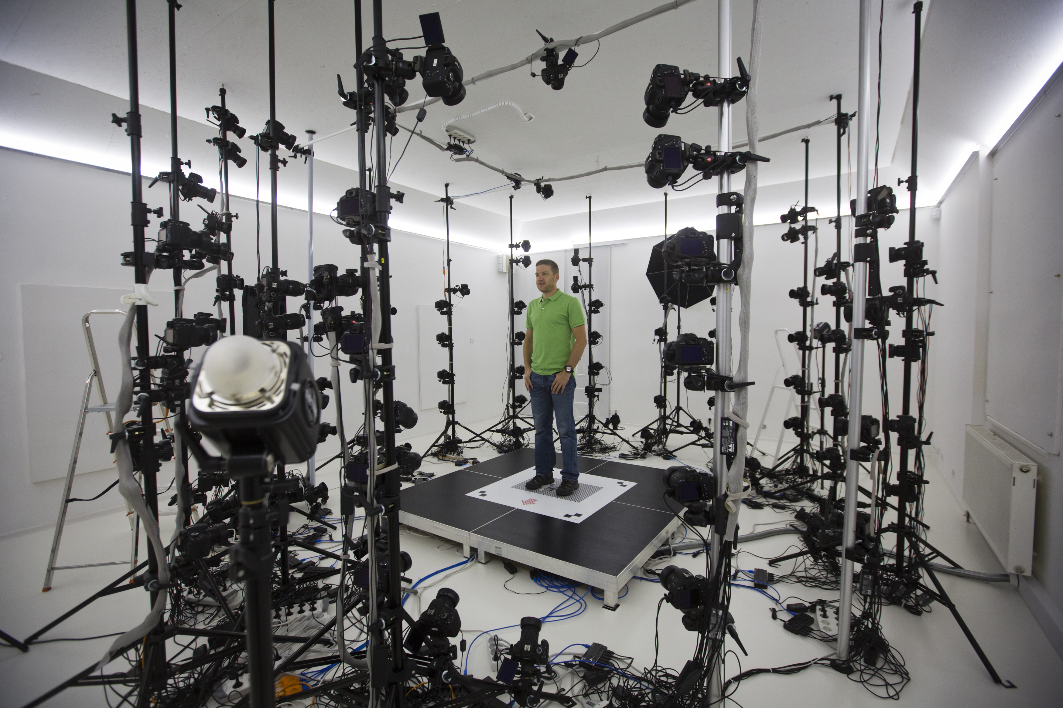 Martin Benes from 3D gang company demonstrates one of the stages of 3D scanning on August 26, 2014 in Prague, Czech Republic. The 3D scanner is the largest in continental Europe, with 115 sensors, and is designed to scan objects, people and animals.