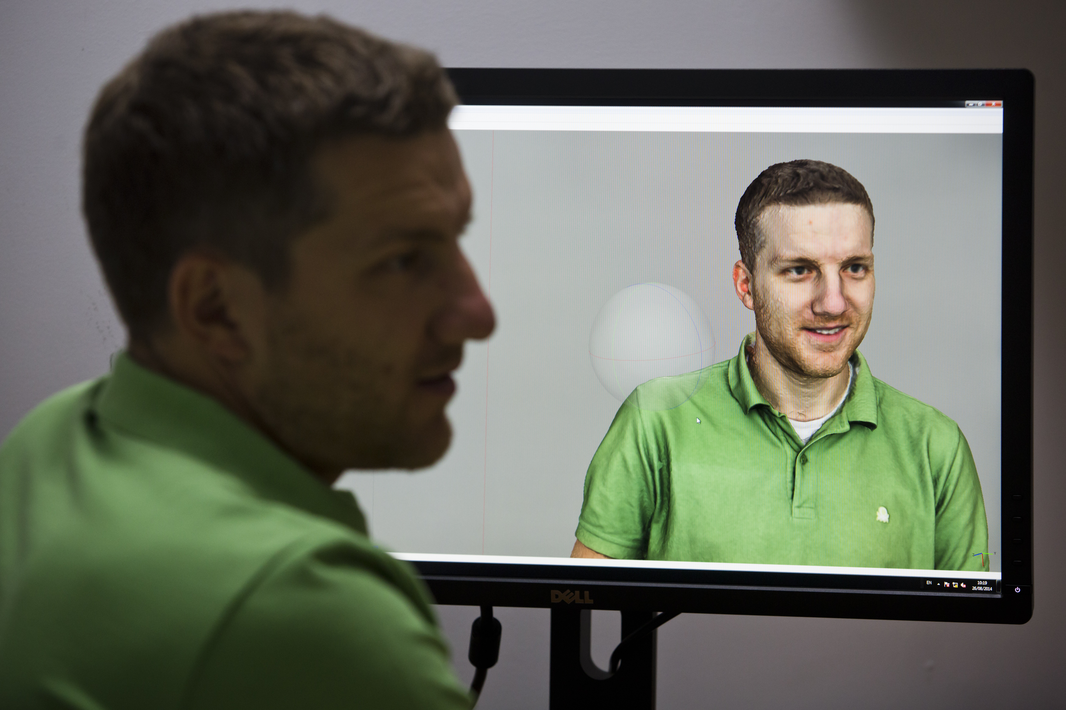 Martin Benes works with a 3D model of himself on the computer on August 26, 2014 in Prague, Czech Republic.