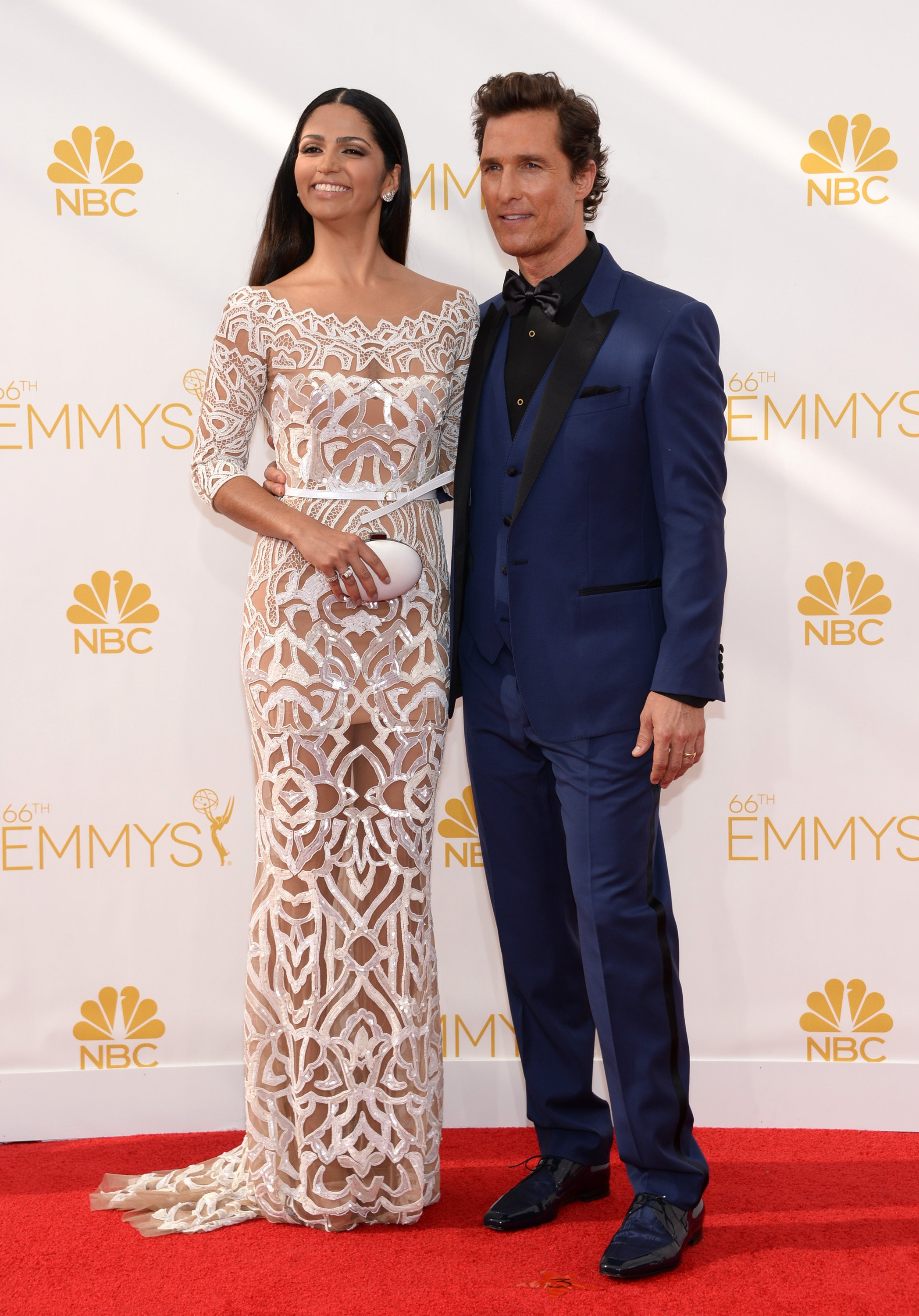 Camila Alves, left, and Matthew McConaughey arrive at the 66th Primetime Emmy Awards at the Nokia Theatre L.A. Live on Monday, Aug. 25, 2014, in Los Angeles.