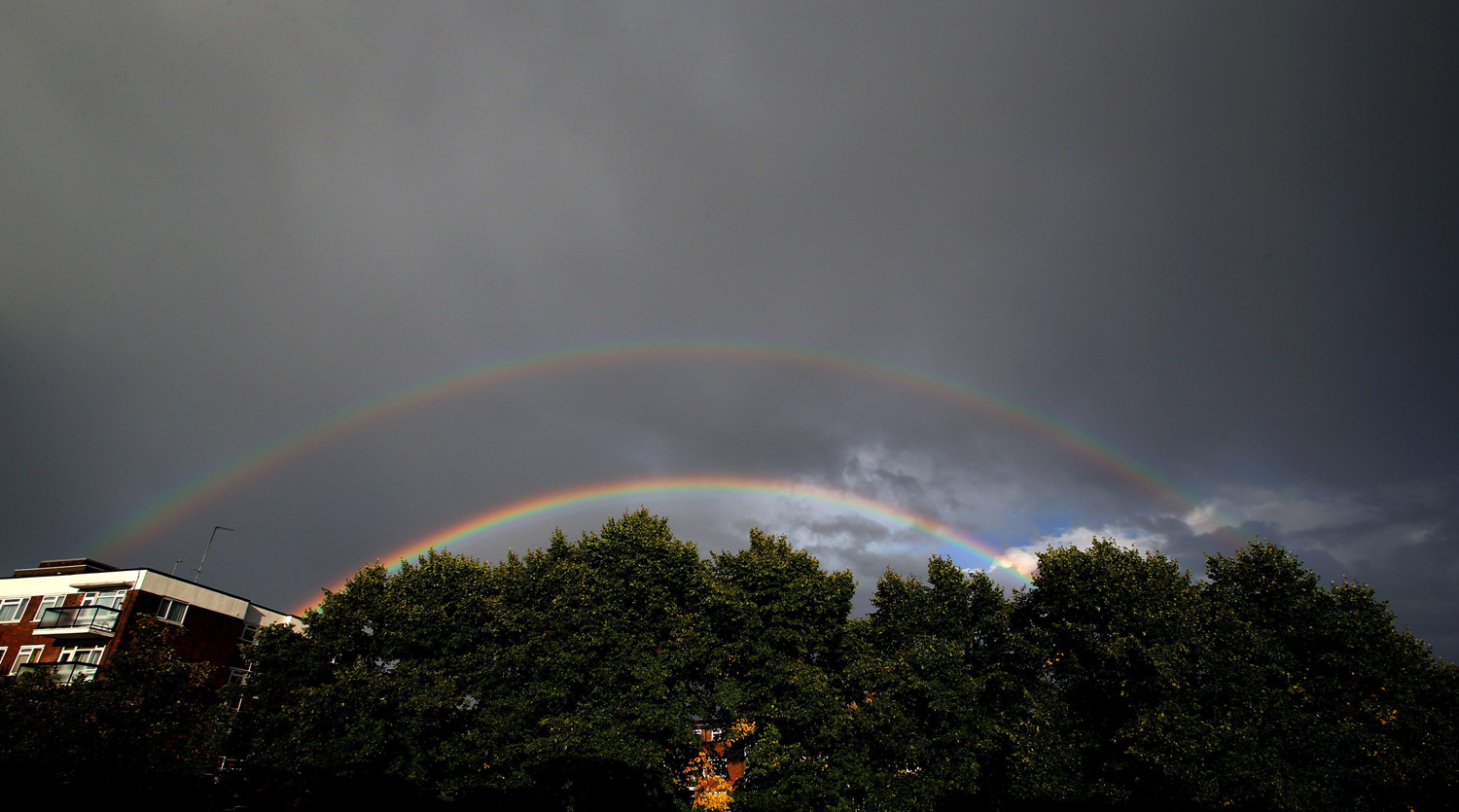 Double rainbows are seen after a heavy rain in London on August 11, 2014.