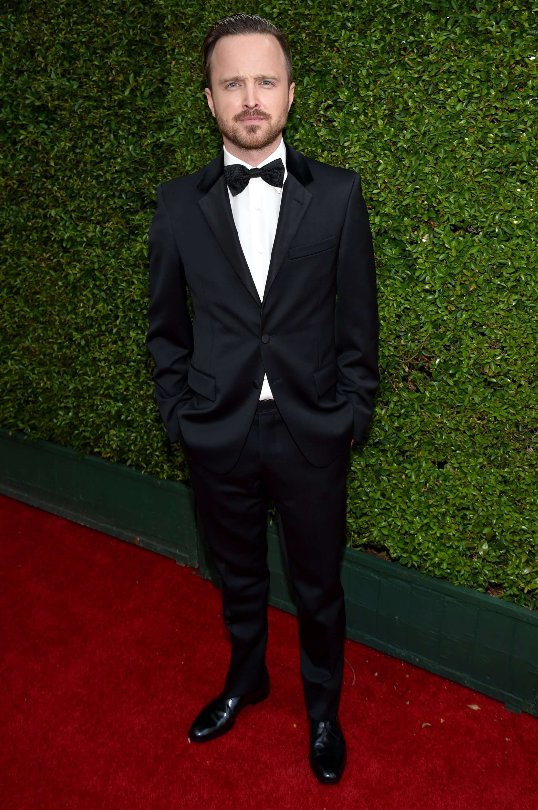 Aaron Paul arrives at the 66th Primetime Emmy Awards at the Nokia Theatre L.A. Live on Monday, Aug. 25, 2014, in Los Angeles.