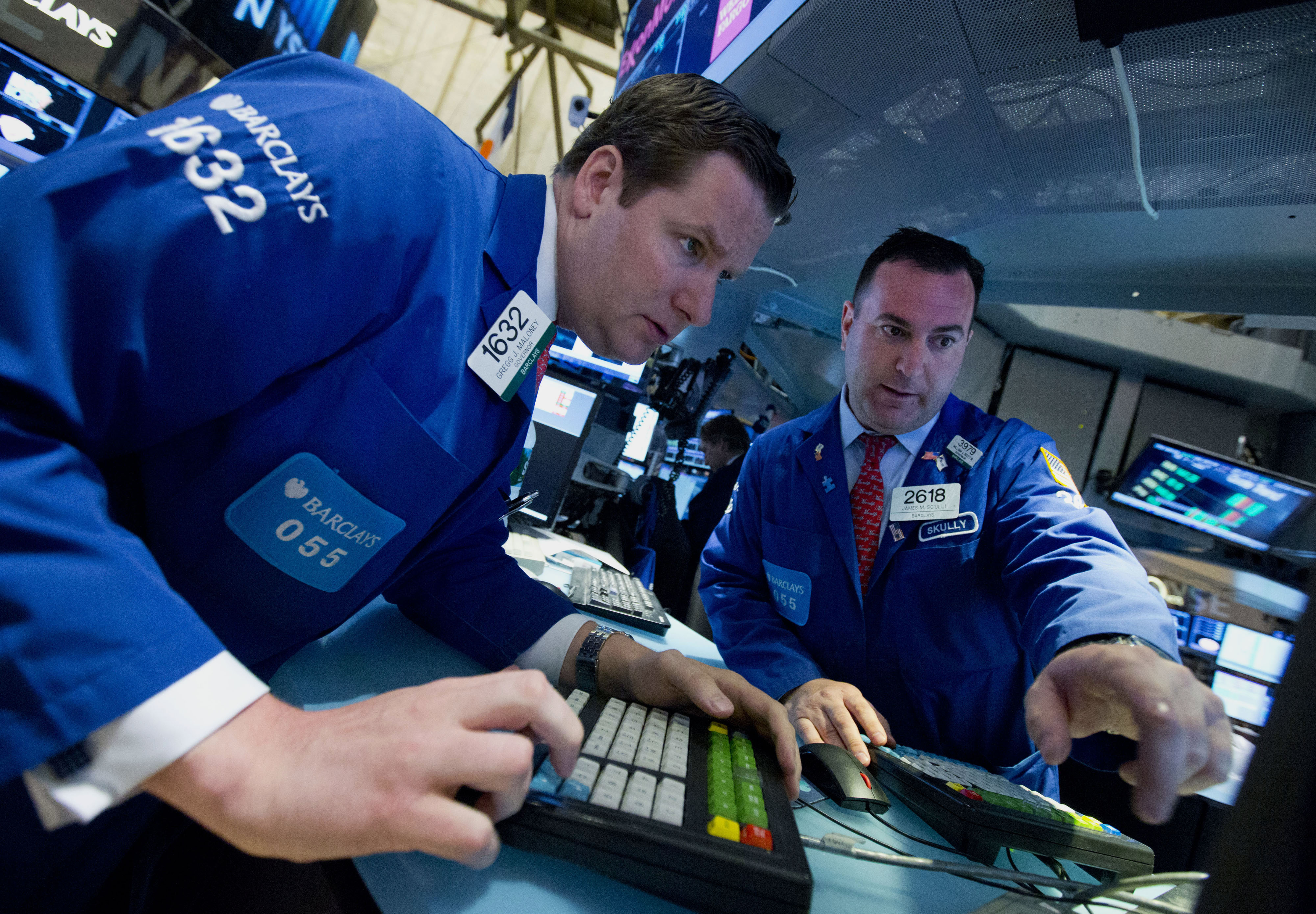 Traders work on the floor of the New York Stock Exchange (NYSE) in New York, U.S., on Monday, June 9, 2014.