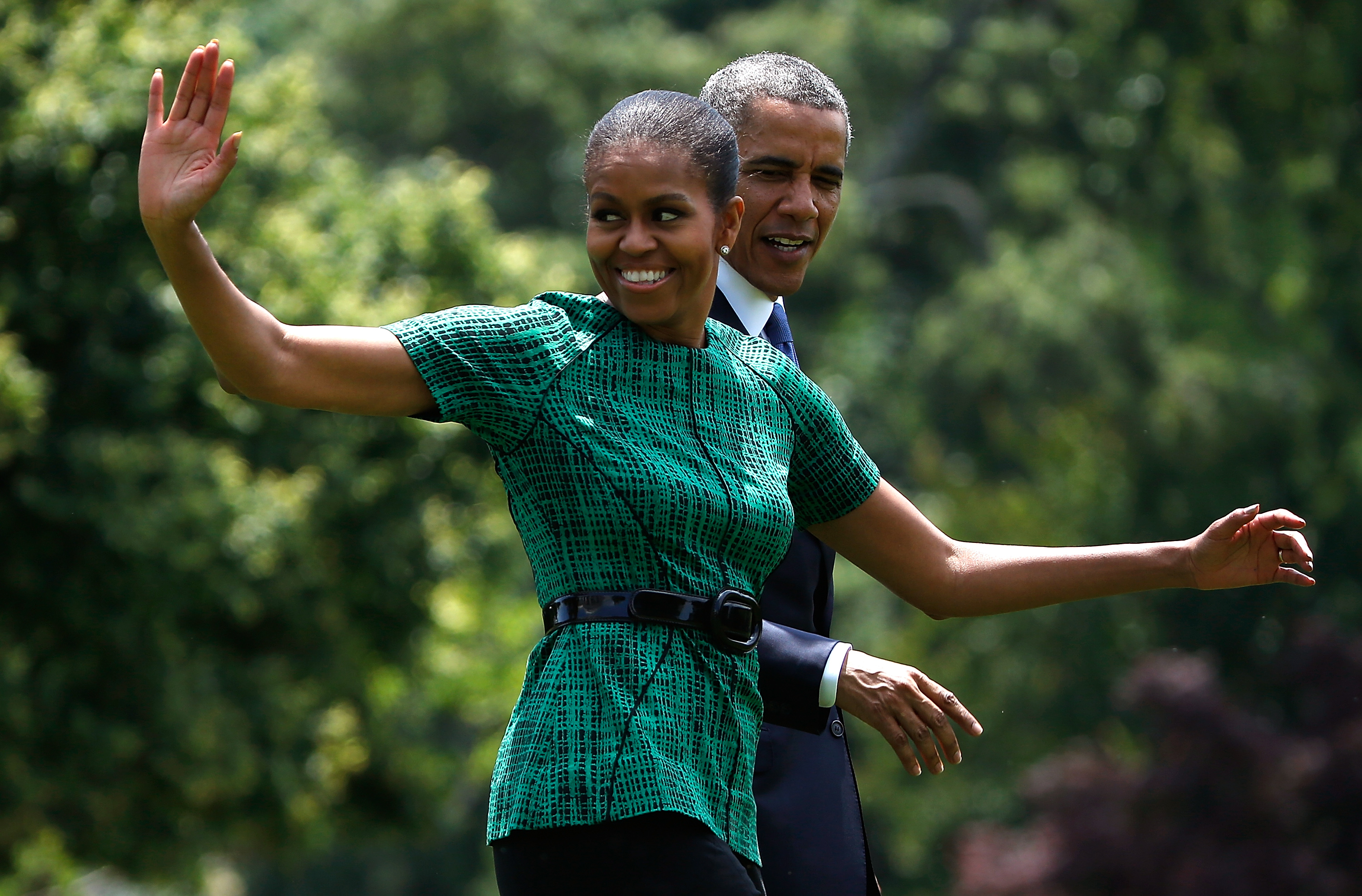 First lady Michelle Obama and U.S. President Barack Obama wave
