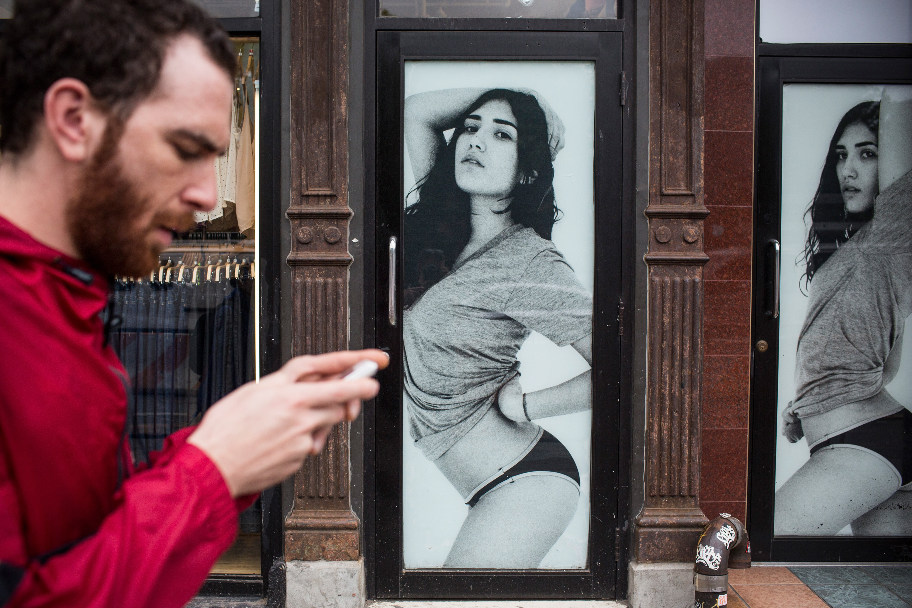 A man walks past an American Apparel store on June 19, 2014 in New York City.
