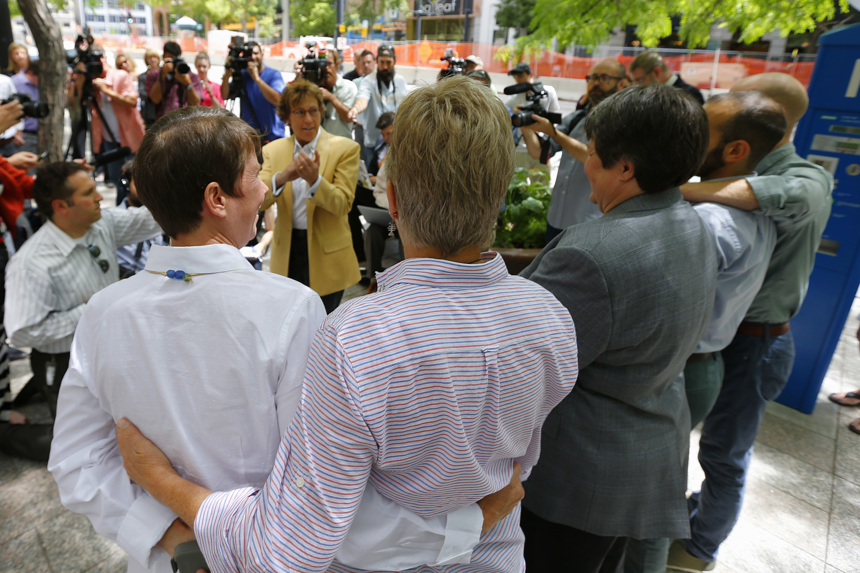 Peggy Tomsic, (C) attorney for three same-sex couples, claps in celebration after the 10th Circuit Court in Denver rejected a same-sex marriage ban in Utah on June 25, 2014 in Salt Lake City, Utah.