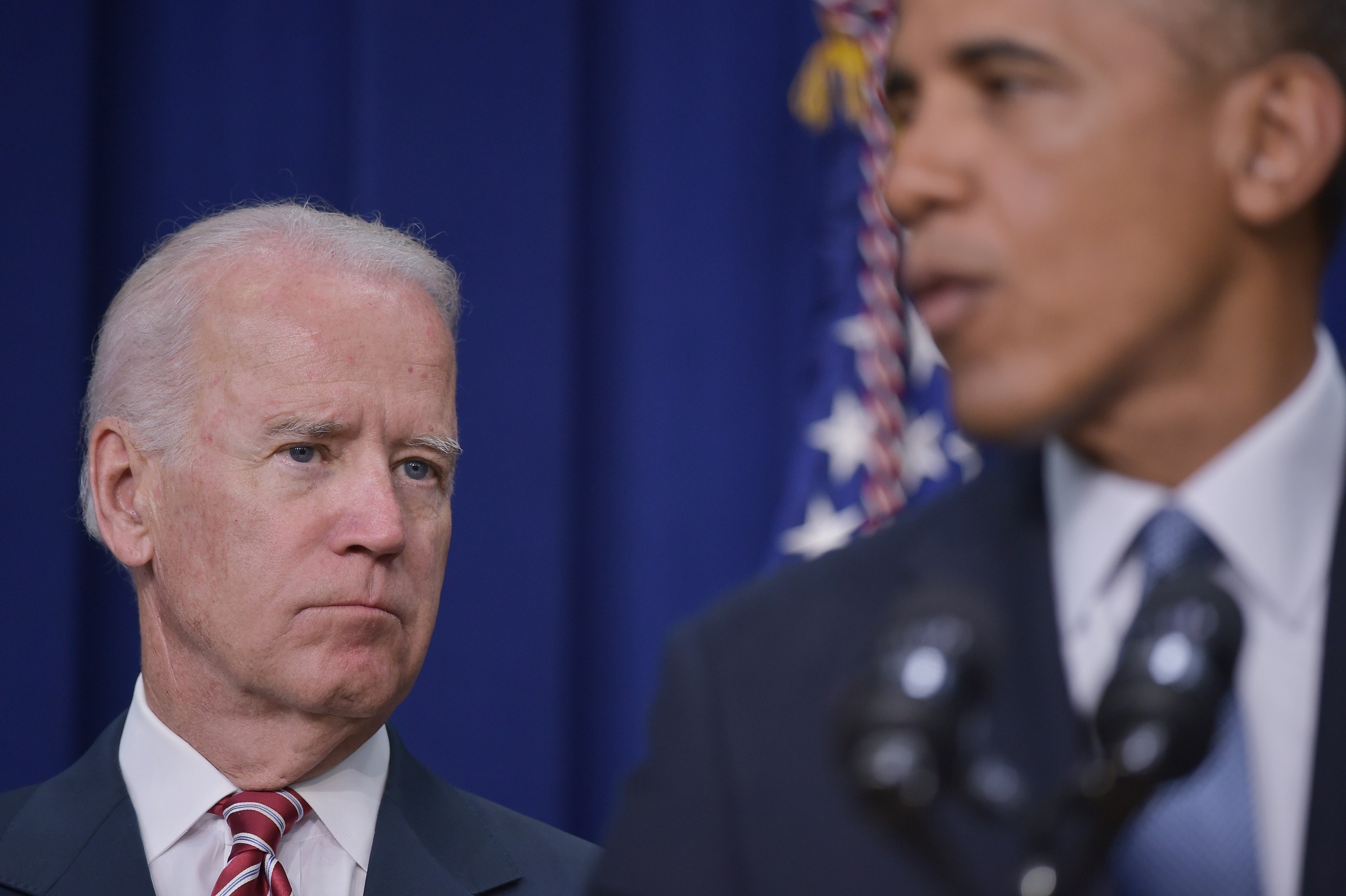Vice President Joe Biden watches as President Barack Obama speaks during a signing ceremony for H.R. 803, the Workforce Innovation and Opportunity Act, on July 22, 2014 in the South Court Auditorium of the Eisenhower Executive Office Building, next to the White House in Washington, DC.