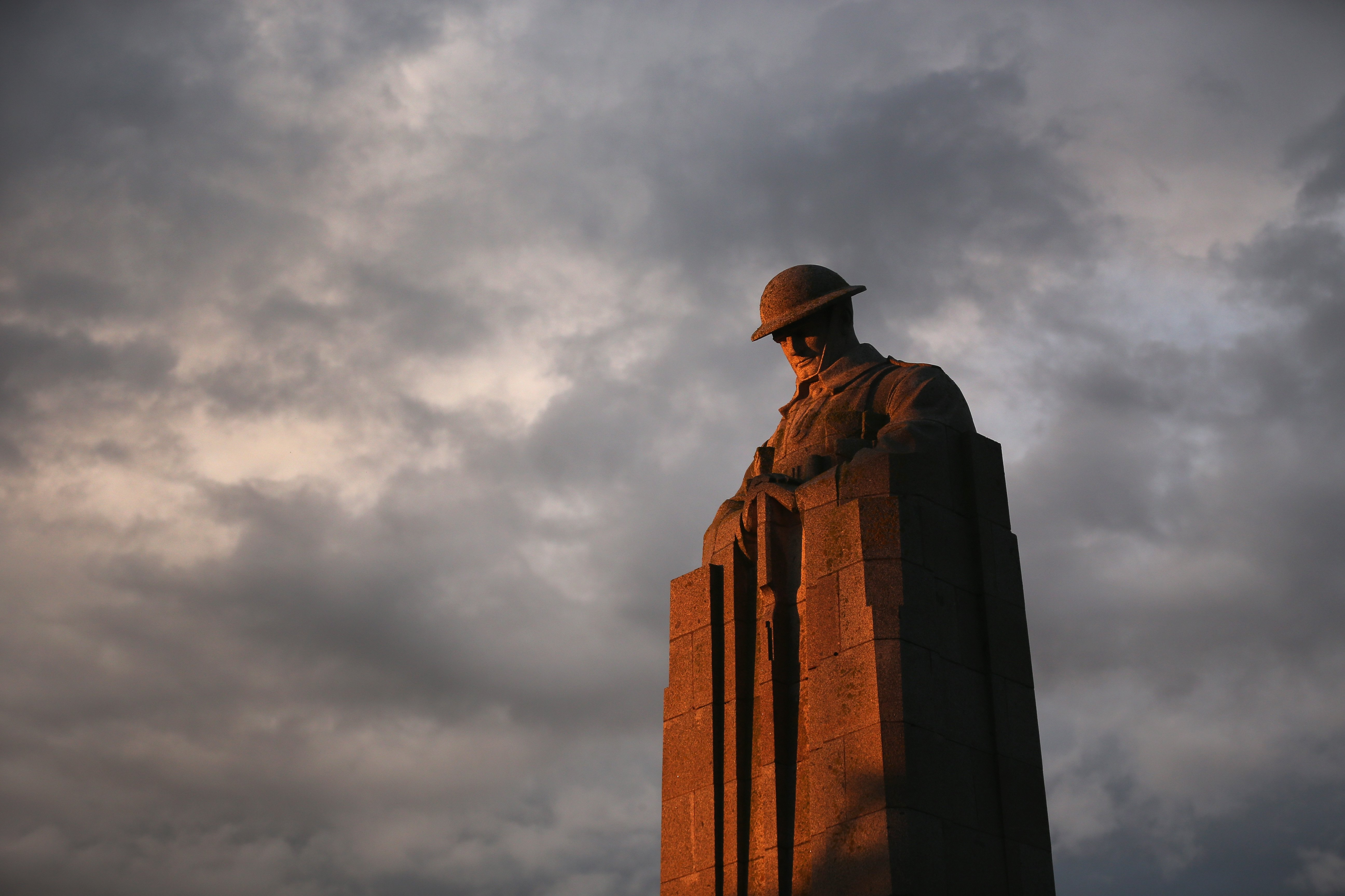 Aug. 2, 2014. The setting sun illuminates the sculpture of the  'Brooding Soldier' the monument commemorates the Canadian First Division's participation in the Second Battle of Ypres of World War I.