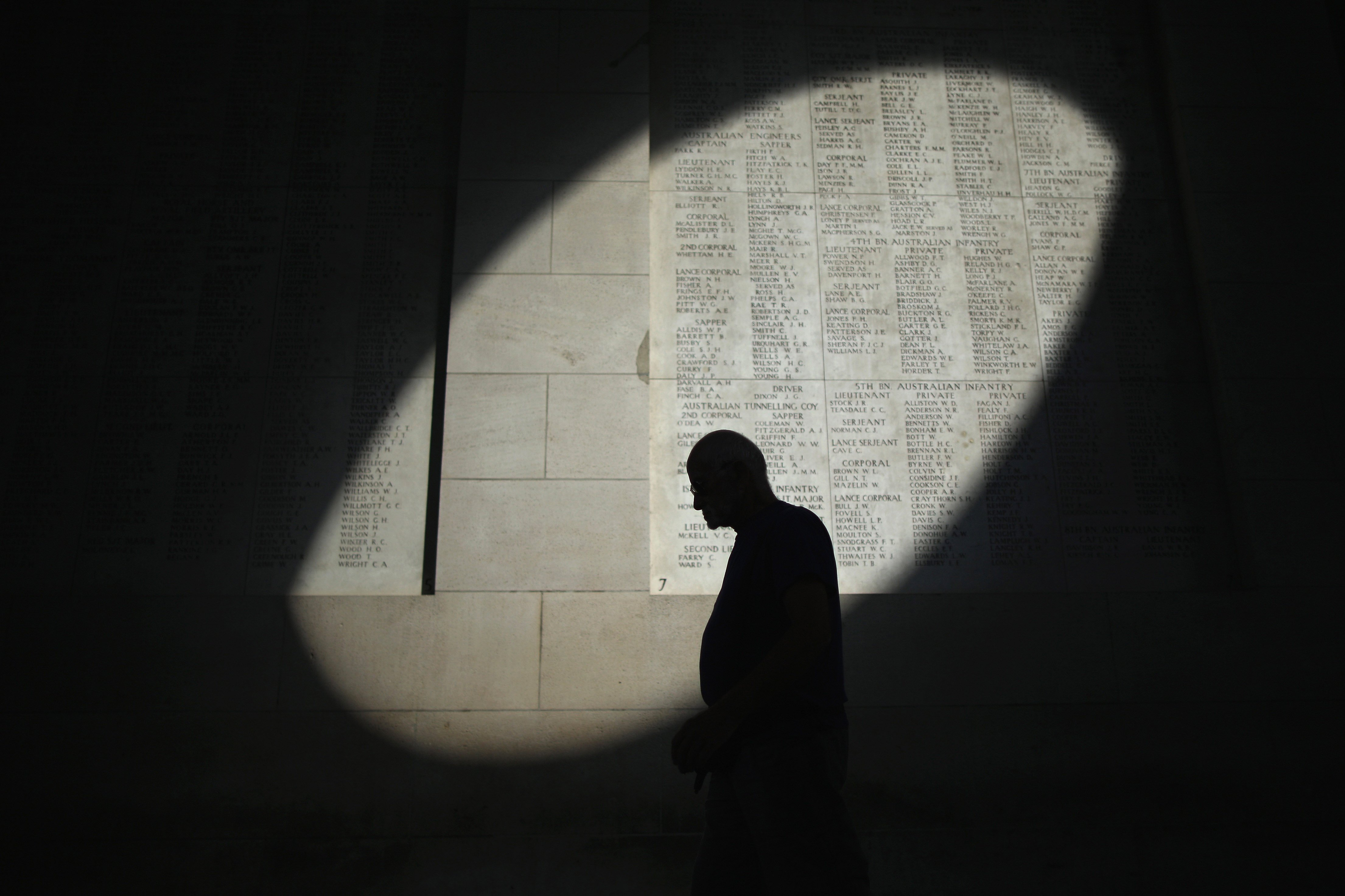 Aug. 4, 2014. A shaft of sunlight falls on the names of the missing at the Menin Gate Memorial on the centenary of the Great War in Ypres, Belgium.