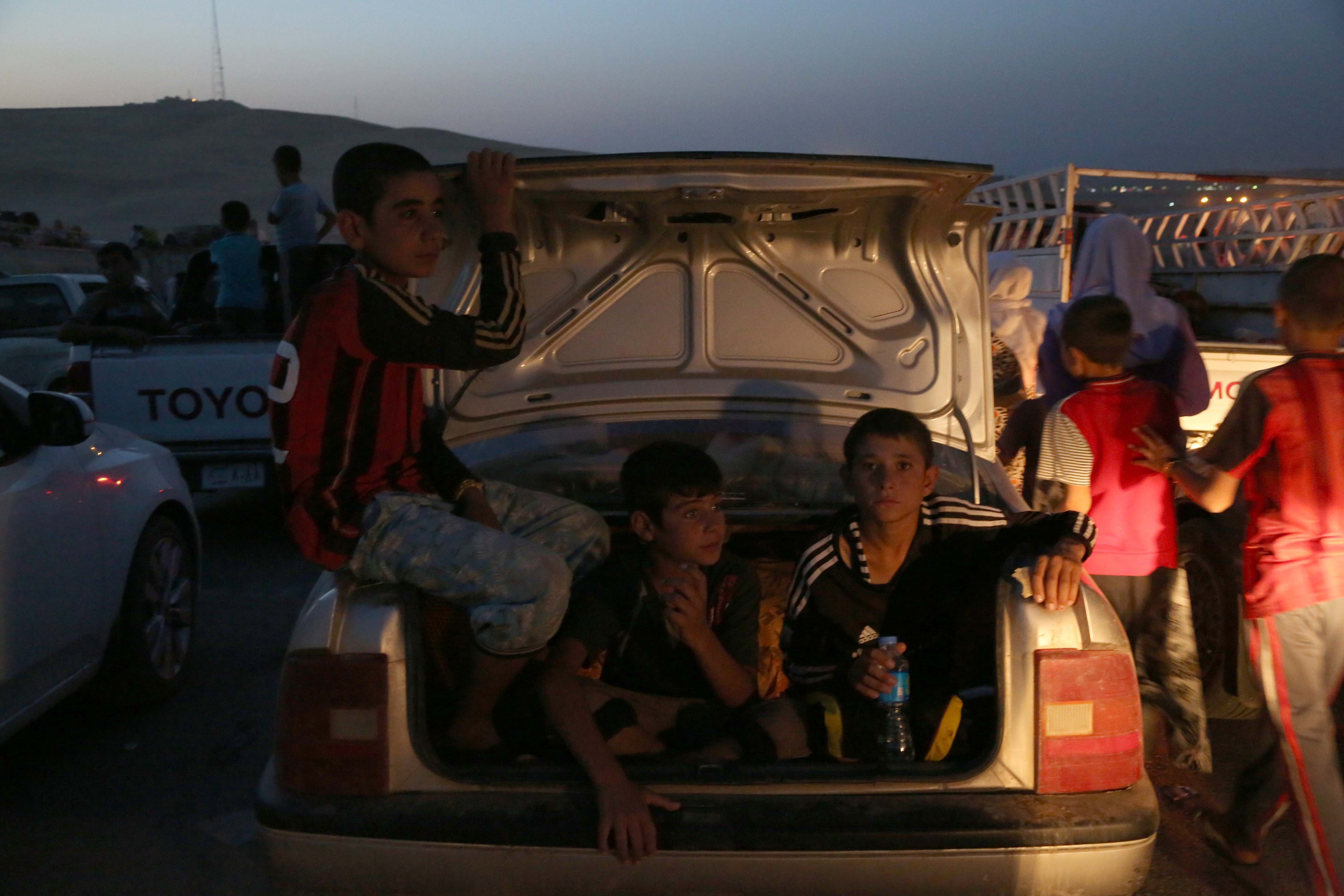Thousands of Iraqis flee from the town of Sinjar, near the city of Mosul, to Erbil and Dohuk after armed groups affiliated with the Islamic State seized the town early on August 4, 2014.