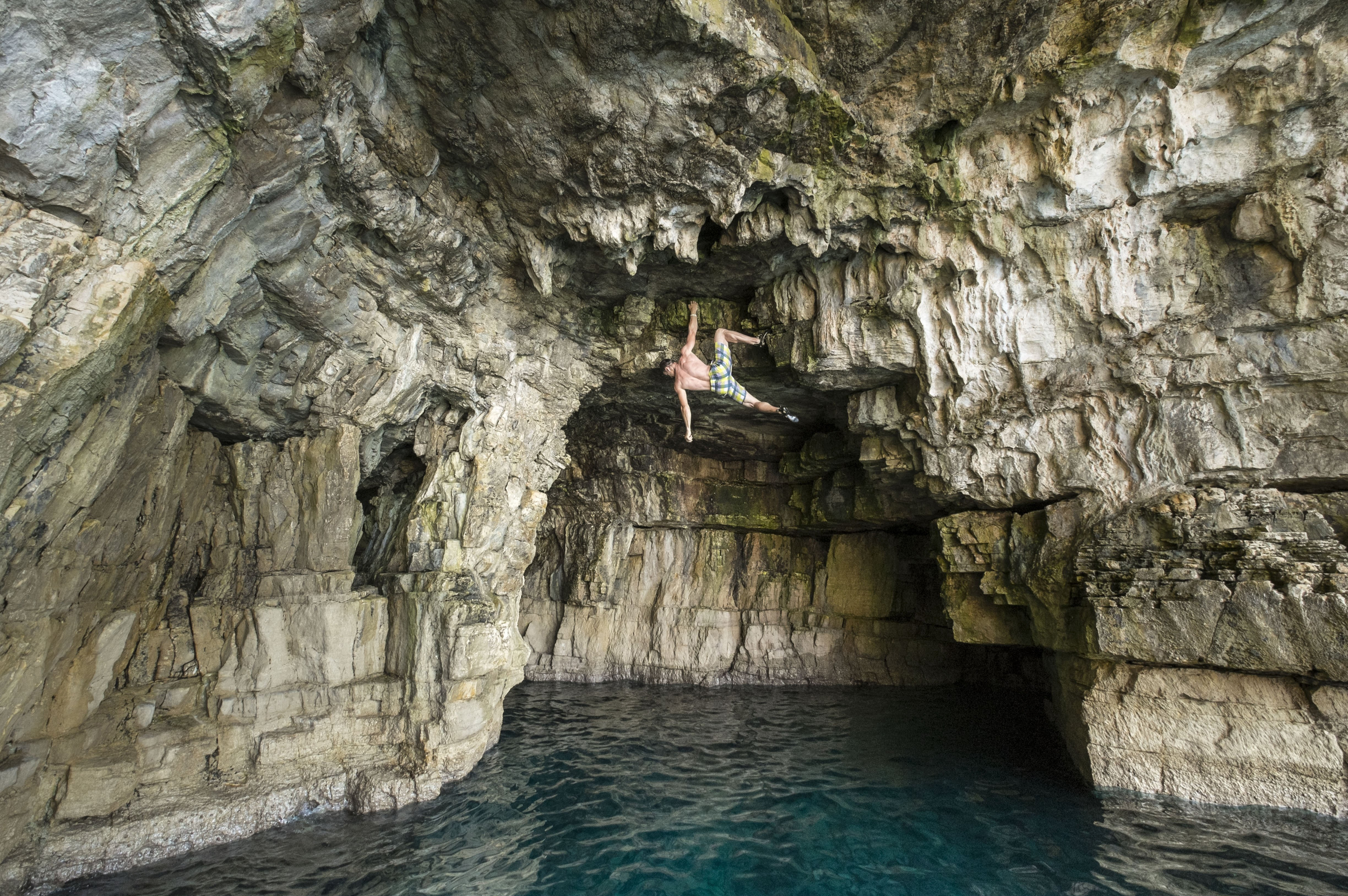 Aug. 4, 2014. Andreas (43) of Austria climbs in an 8 to 10 meter-high cave of Stoja near Pula, Croatia. There are many opportunities for the so called 'deep water soloing' - free climbing over the water - at the mile-long cliffs of Croatia.