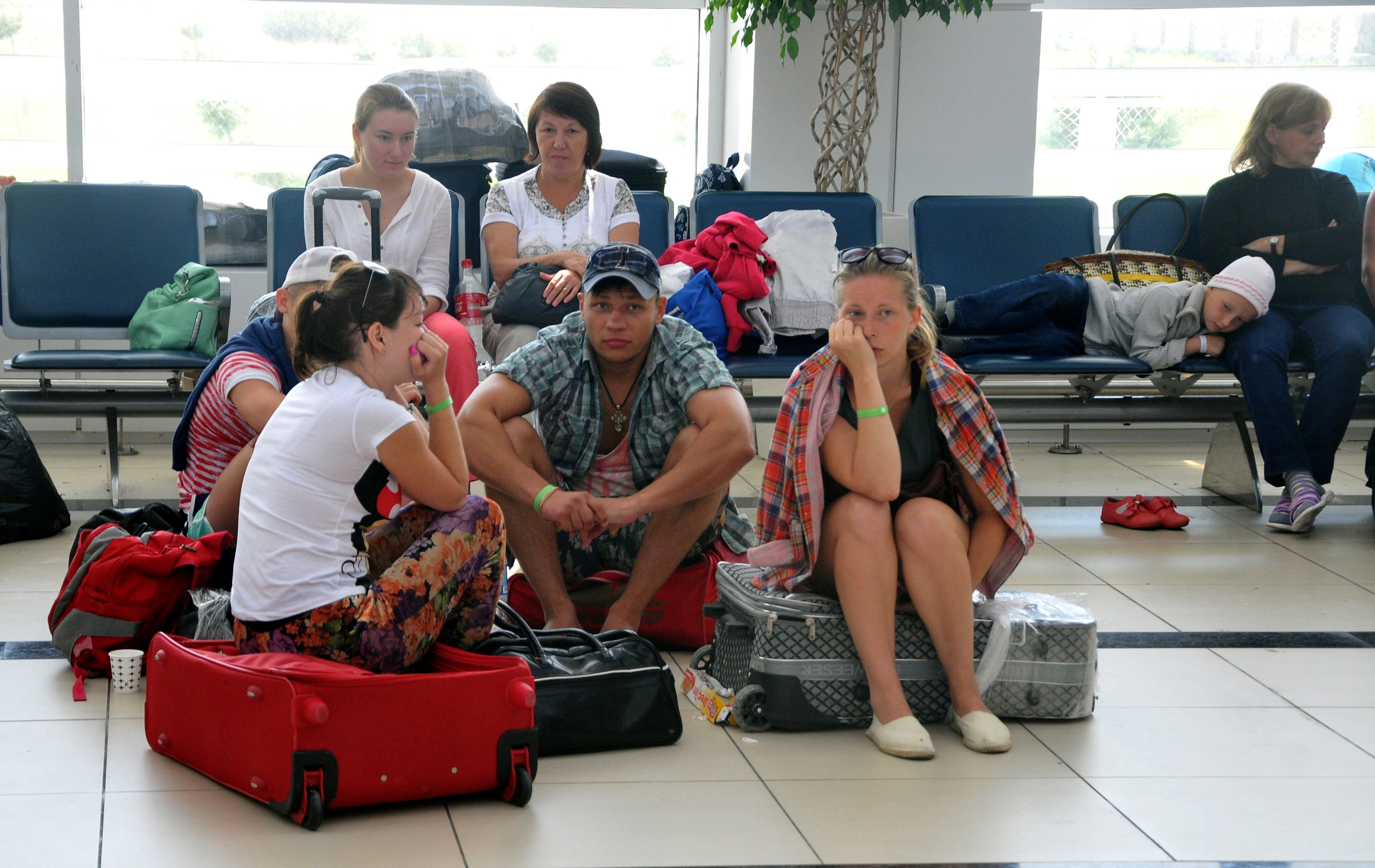 A group of 30 Russian tourists wait at Antalya Airport in Turkey on Aug. 4, 2014,  after their Russian tour company went bankrupt