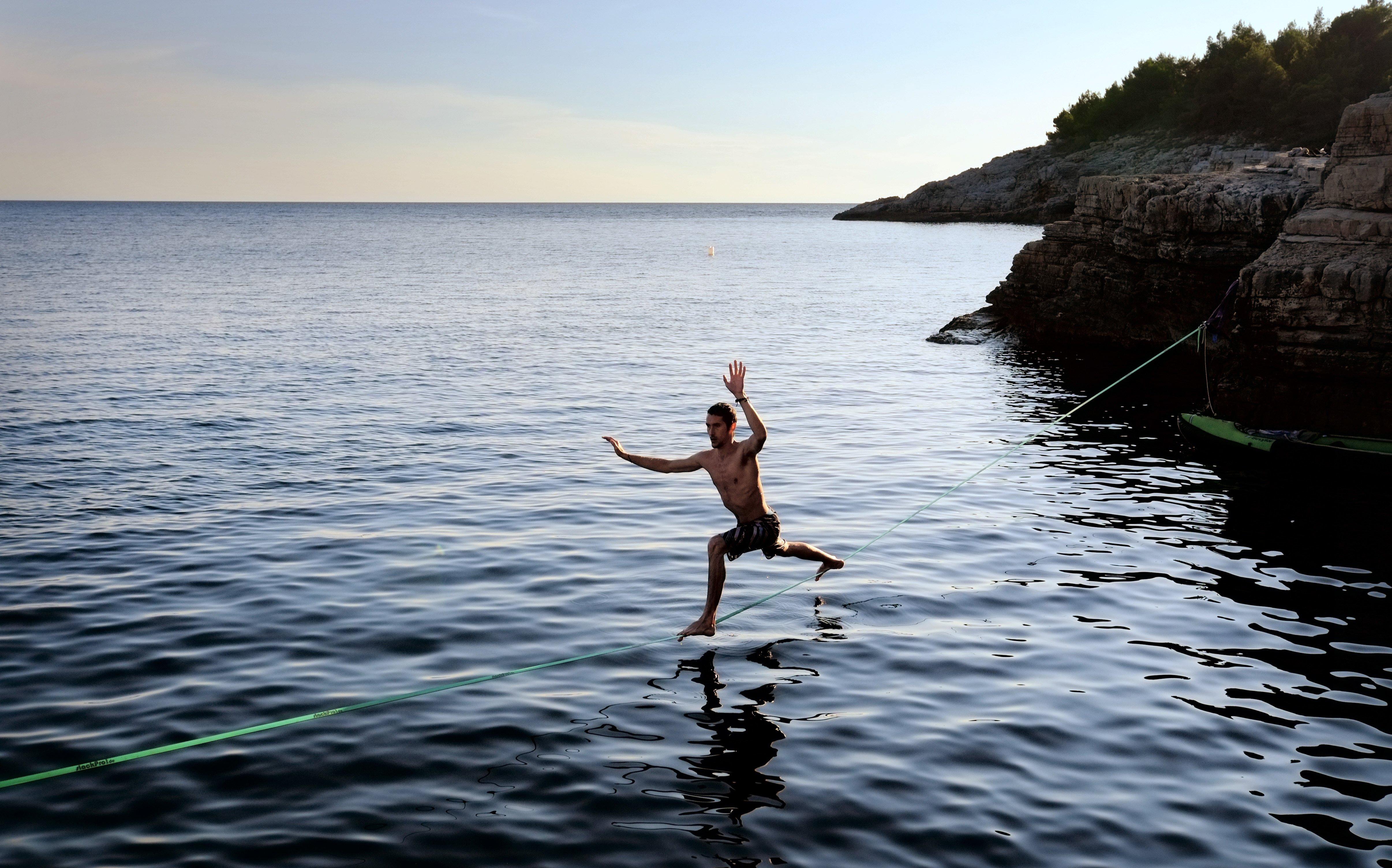 Aug. 5, 2014.  A climber walks over a slackline at the cliffs of Stoja near Pula, Croatia.