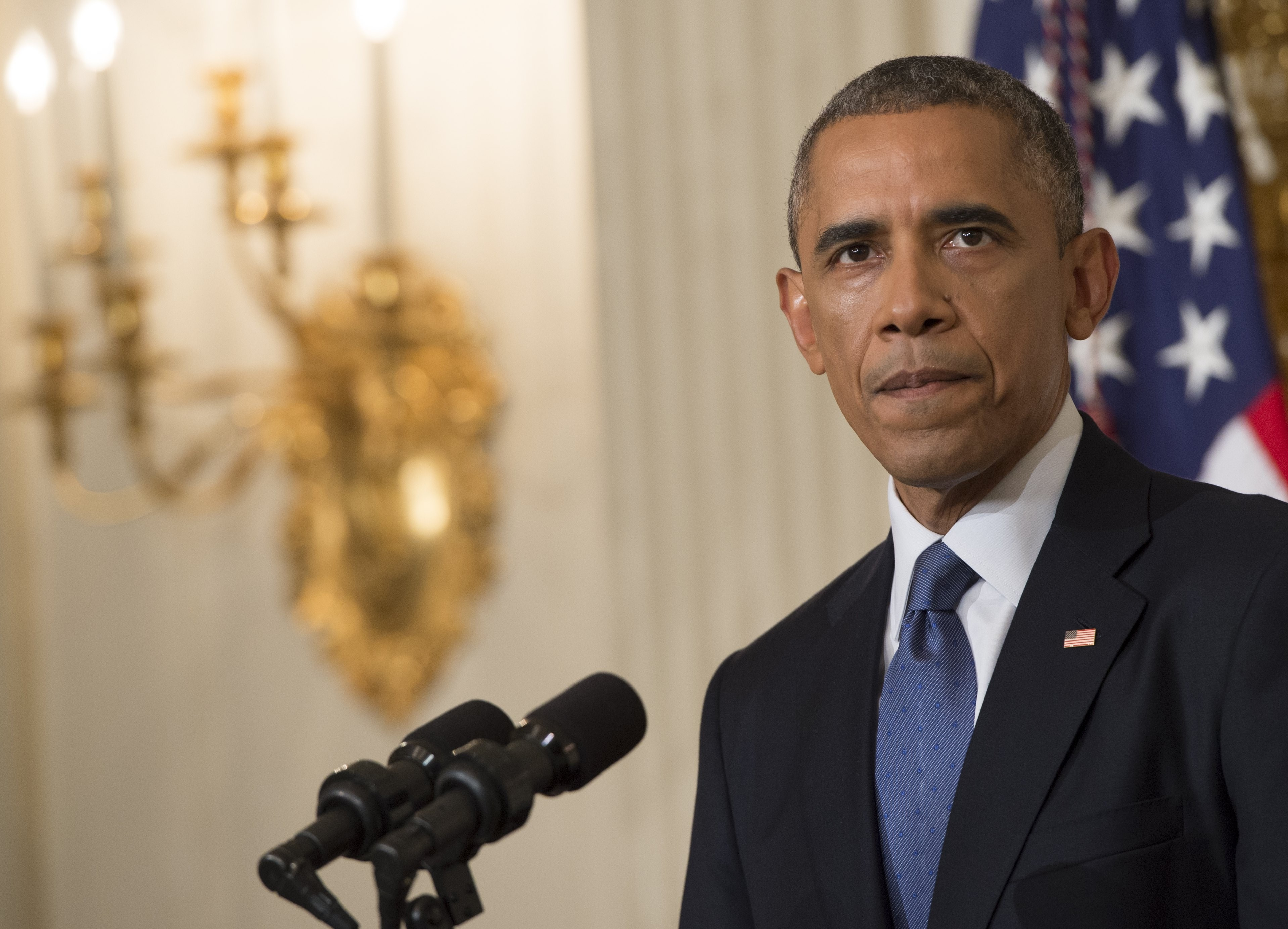 President Barack Obama speaks about the situation in Iraq in the State Dining Room at the White House in Washington, DC, August 7, 2014.