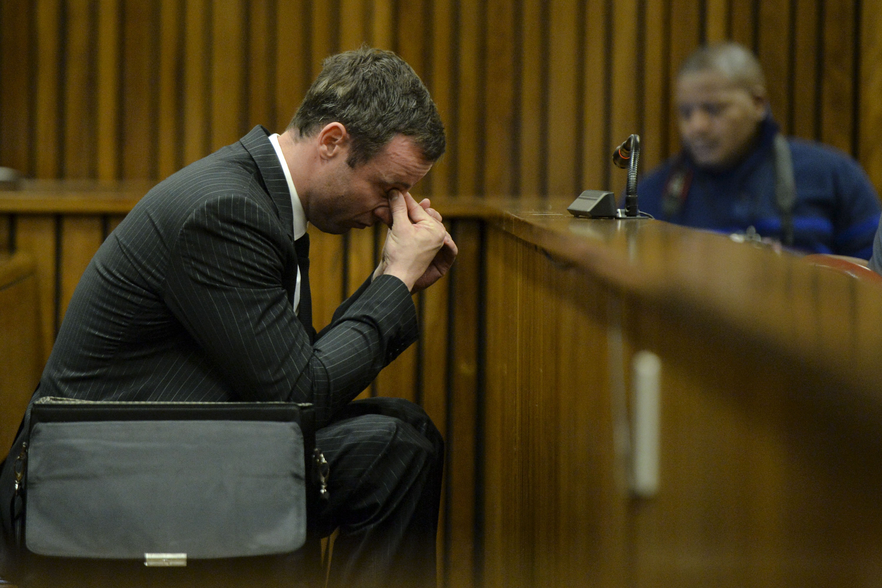 Oscar Pistorius sits in the dock during closing arguments in his murder trial in the Pretoria High Court on August 8, 2014, in Pretoria, South Africa.
