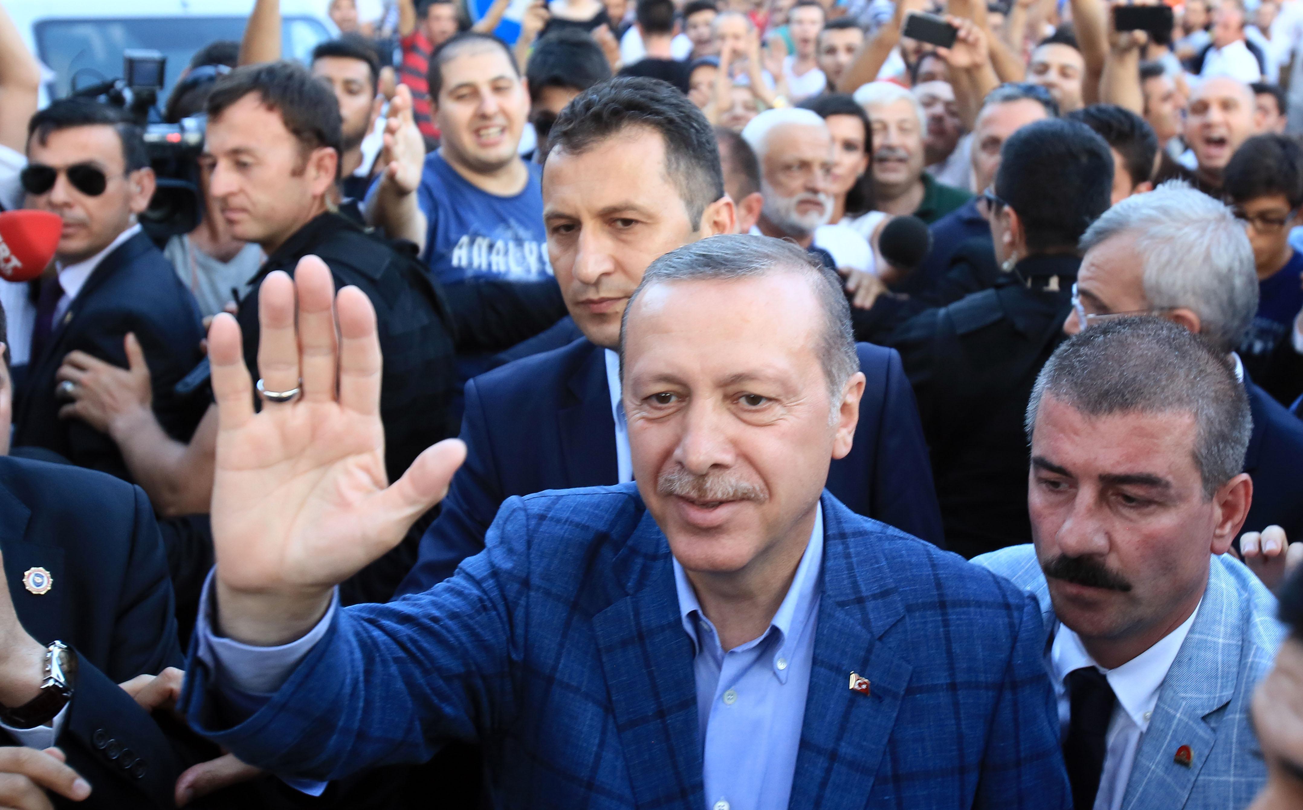 Winner of Turkey's presidential election Recep Tayyip Erdogan greets the public in Istanbul on Aug. 10, 2014