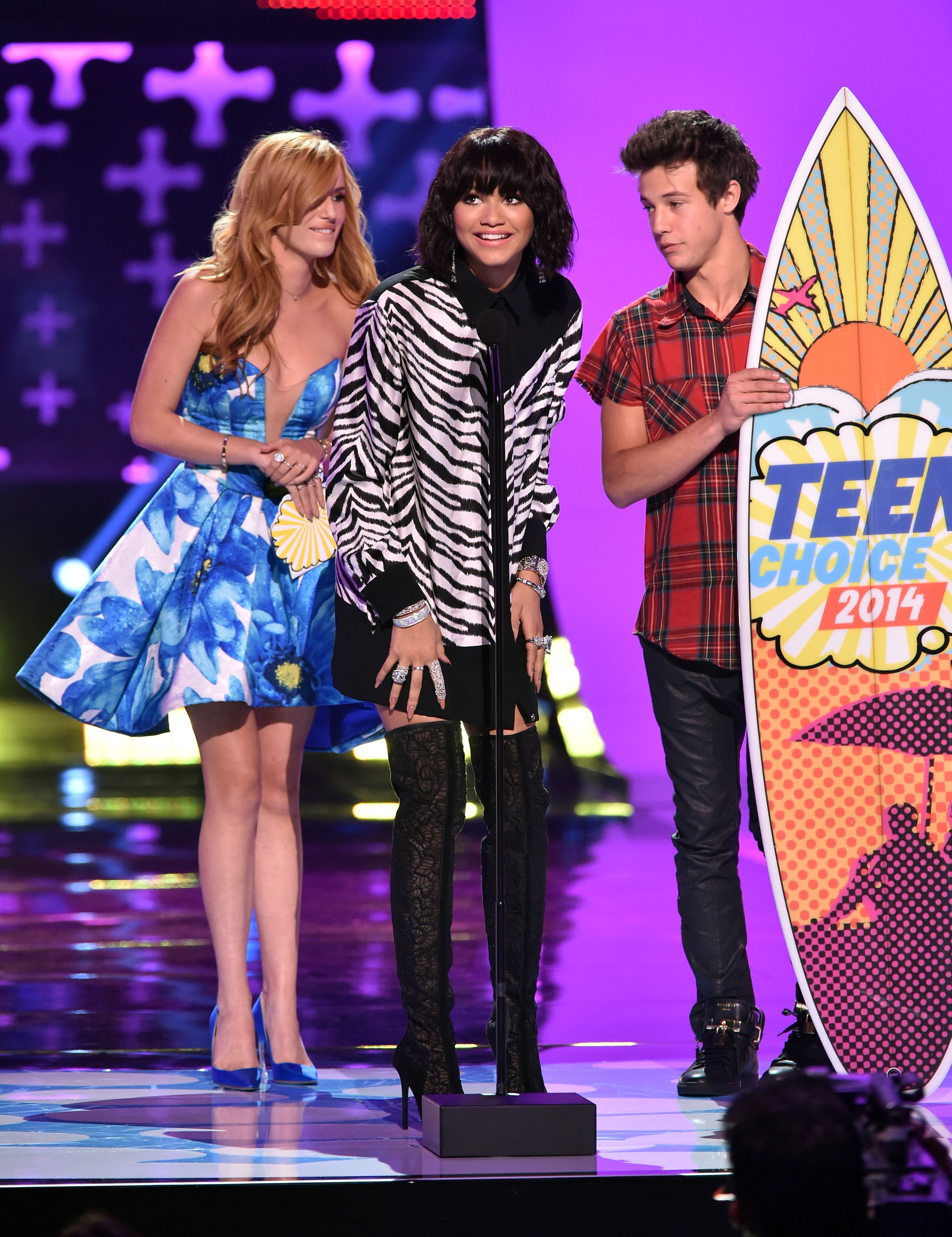 (L-R) Actress Bella Thorne, actress Zendaya, and internet personality Cameron Dallas onstage during FOX's 2014 Teen Choice Awards at The Shrine Auditorium on August 10, 2014 in Los Angeles, California.