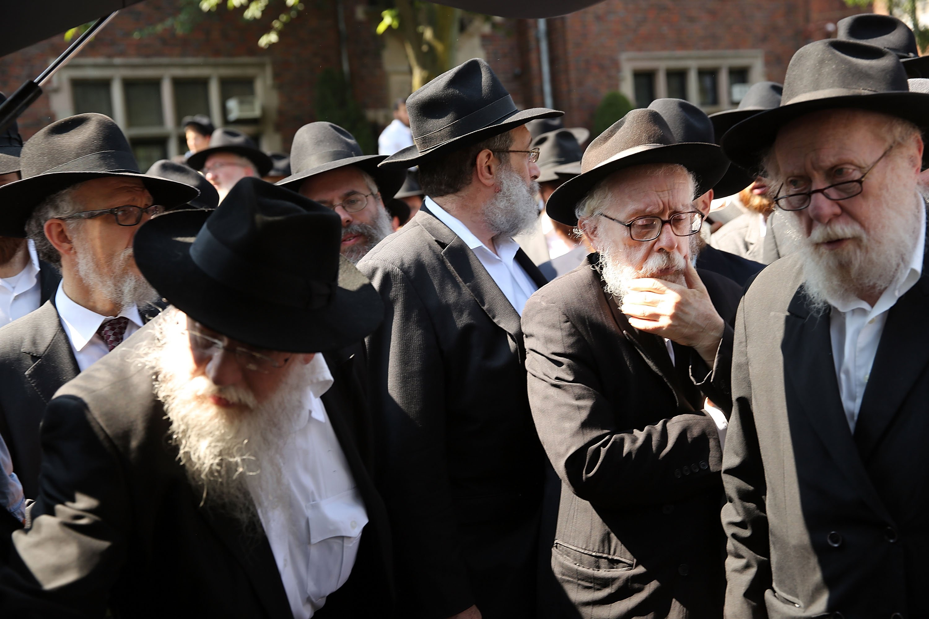 Mourners follow a hearse outside the Chabad-Lubavitch headquarters for the funeral of Rabbi Joseph Raksin in the Brooklyn borough of New York City on Aug. 11, 2014.