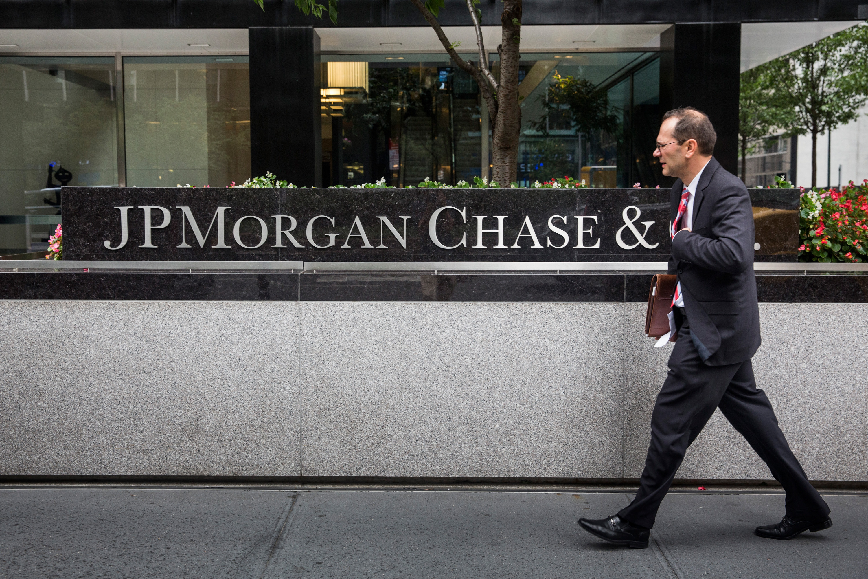 A man walks past JP Morgan Chase's corporate headquarters on August 12, 2014 in New York City.