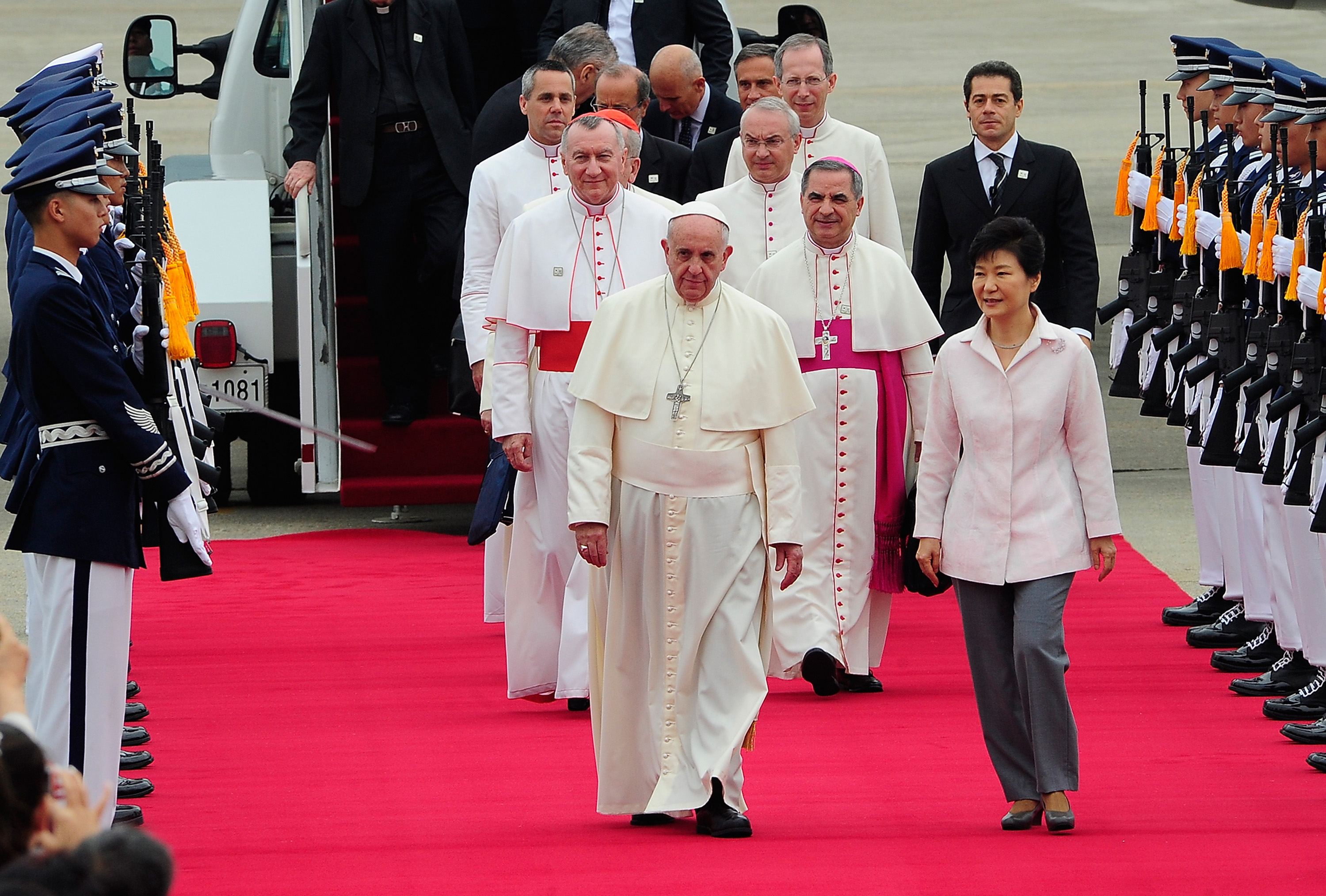 Pope Francis walks with South Korean President Park Geun-Hye upon his arrival on August 14, 2014 in Seoul, South Korea.