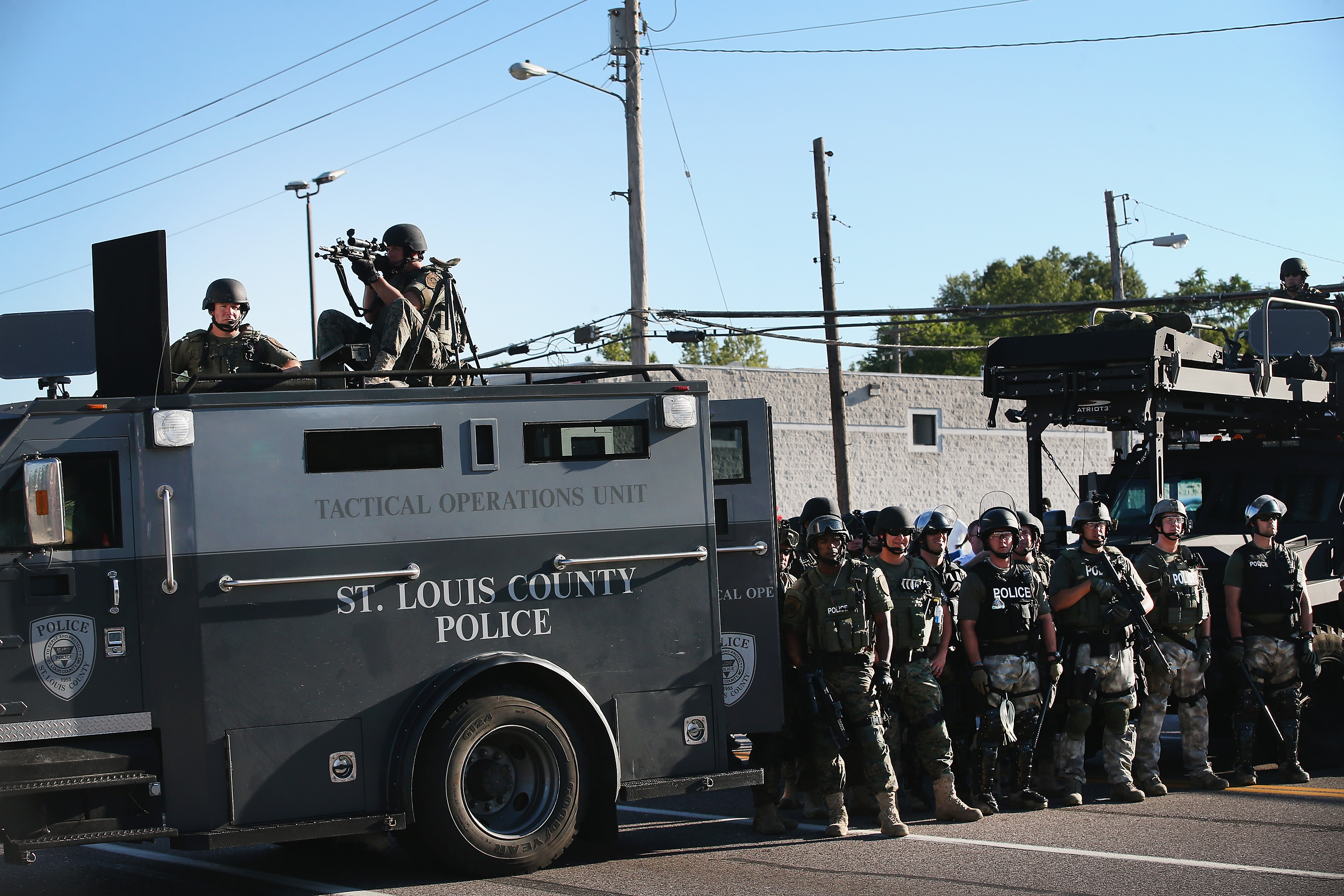 Police on guard in Ferguson on Tuesday.
