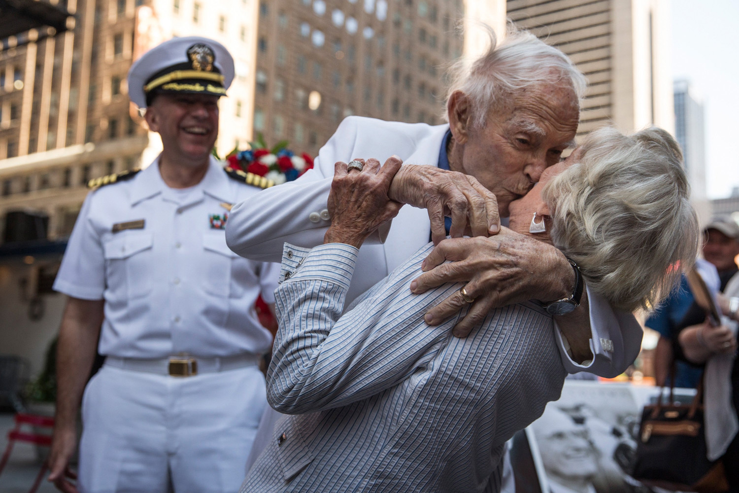 Sydnor Thompson, 90, kisses his wife, Harriette Thompson, 91, while reenacting the Times Square Kiss photo, taken by Alfred Eisenstaedt, to mark the 69-Anniversary of the end of World War Two victory over Japan on August 14, 2014 in Times Square in New York City.