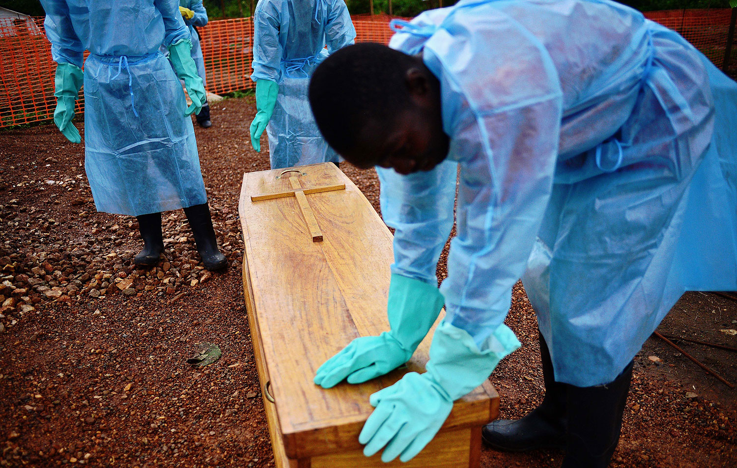 A Sierra Leone government burial team with the coffin of Dr Modupeh Cole, Sierra Leone's second senior physician to die of Ebola, at the MSF facility in Kailahun, Sierra Leone, on Aug. 14, 2014.