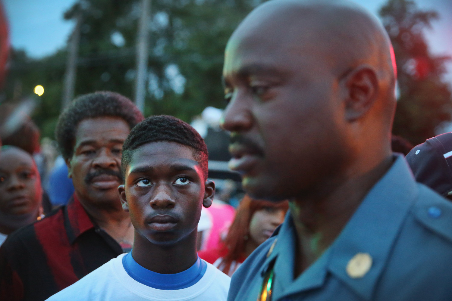 Aug. 16, 2014. Capt. Ronald Johnson (R) of the Missouri State Highway Patrol, who was appointed by the governor to take control of security operations in the city of Ferguson, greets demonstrators in Ferguson, Missouri.