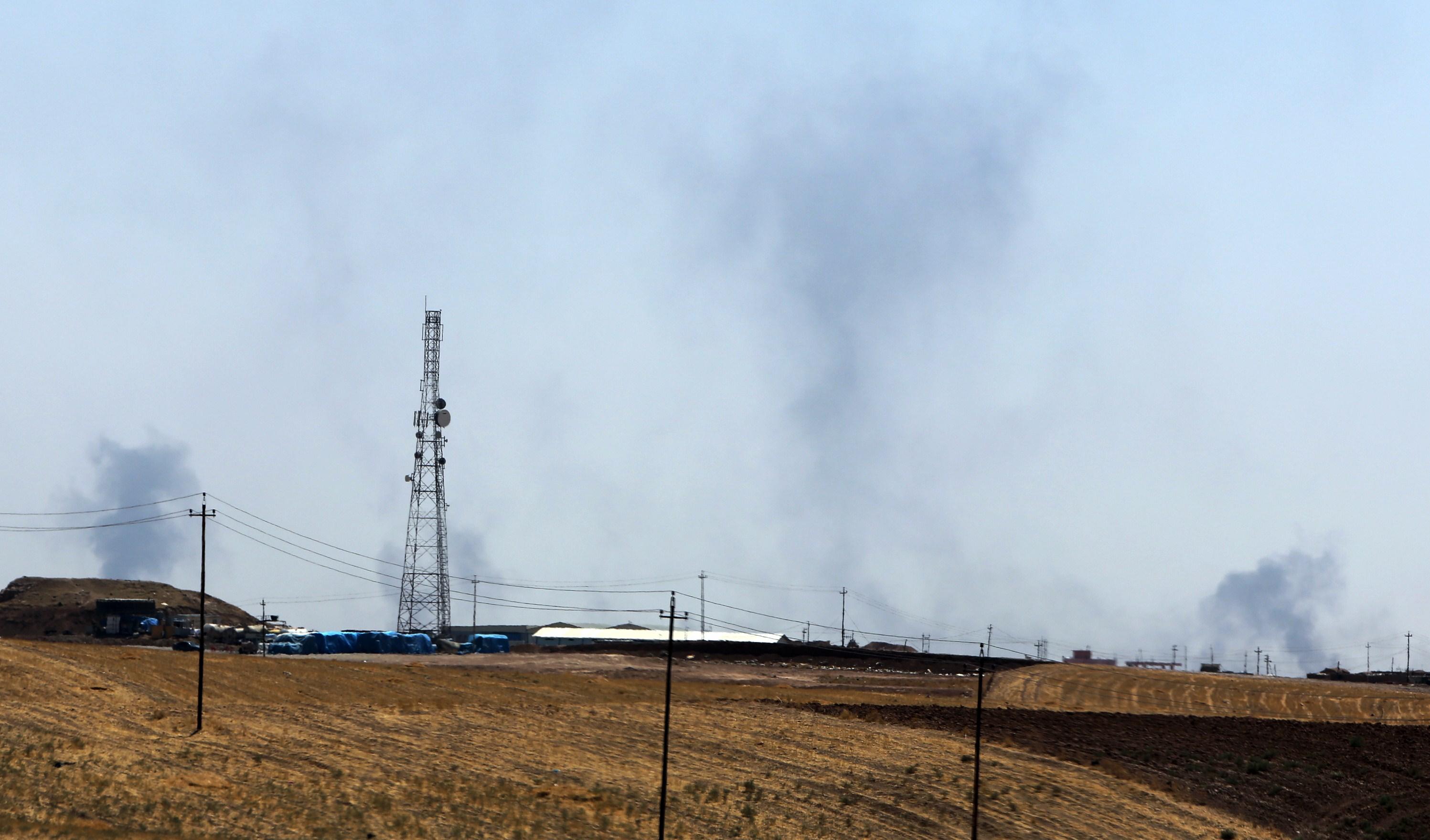 Smokes rises from U.S. air strikes near Mosul dam on Sunday.