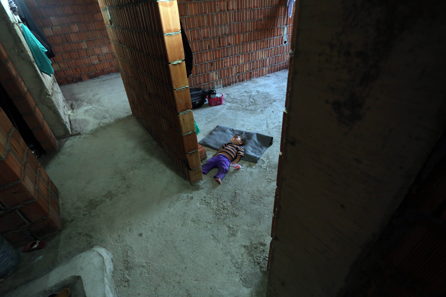 Aug. 16, 2014. Yezidis who fled their home due to the assaults of army groups led by Islamic State (IS), formerly known as ISIL, take shelter in the buildings under construction in Zakho district, a few kilometers from the Iraqi-Turkish border, Dohuk.